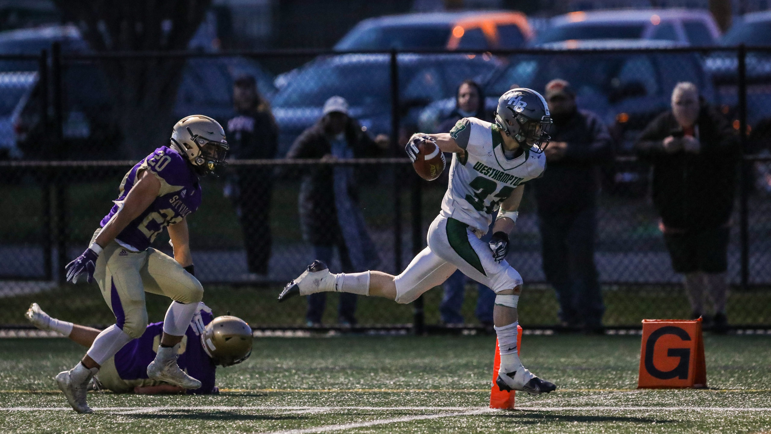 Senior Gavin McIntyre eludes a pair of Sayville defenders and crosses the goal line for what was the Hurricanes only touchdown of the game.