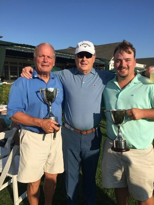 Chris, left, and C.J. Andrews, right, with golf pro Bobby Jenkins, after winning the Father-Son Golf Tournament July 2017 at the Westhampton Country Club.