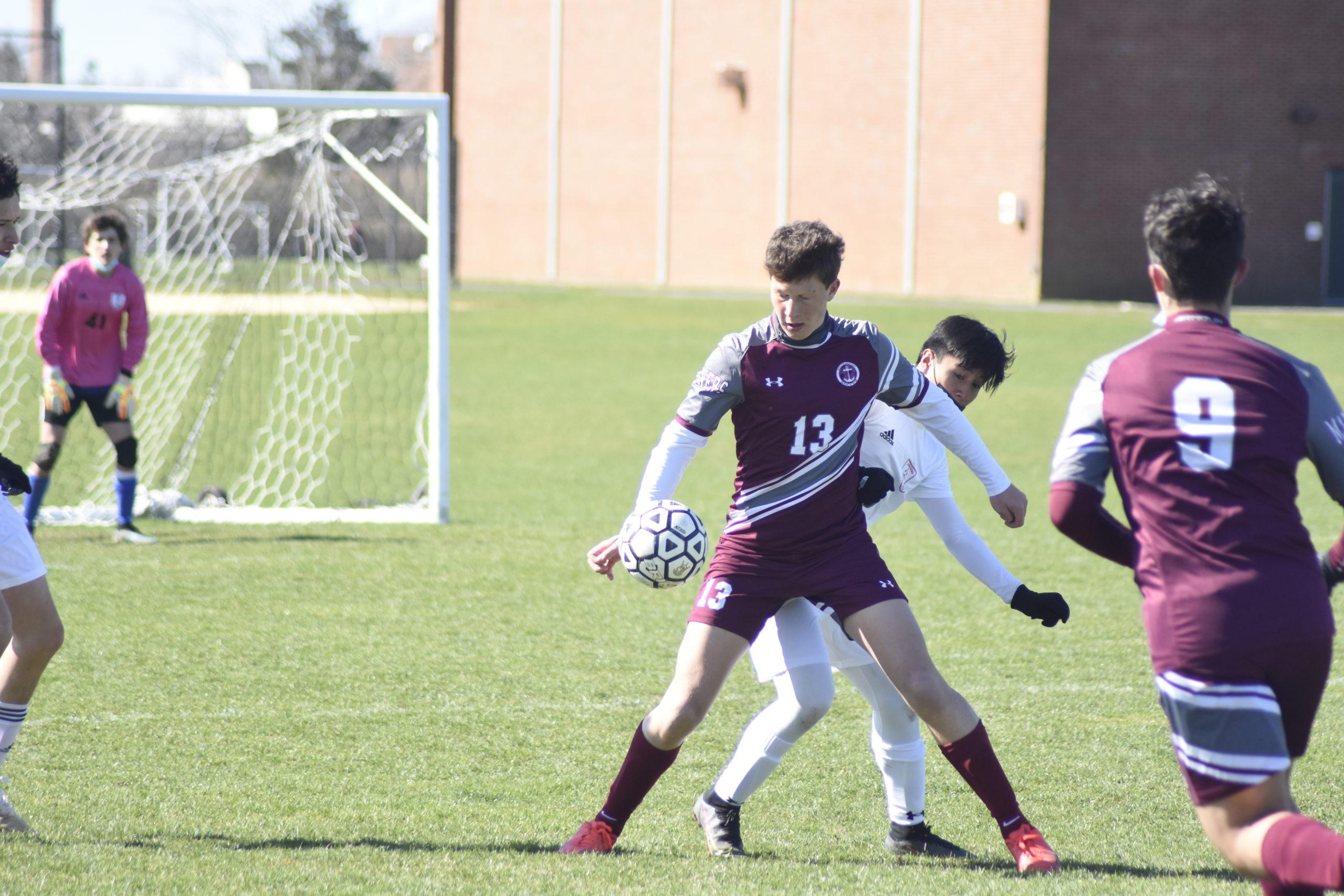The ball touches Southampton senior Griffin Schwartz's hand for inadvertent handball.