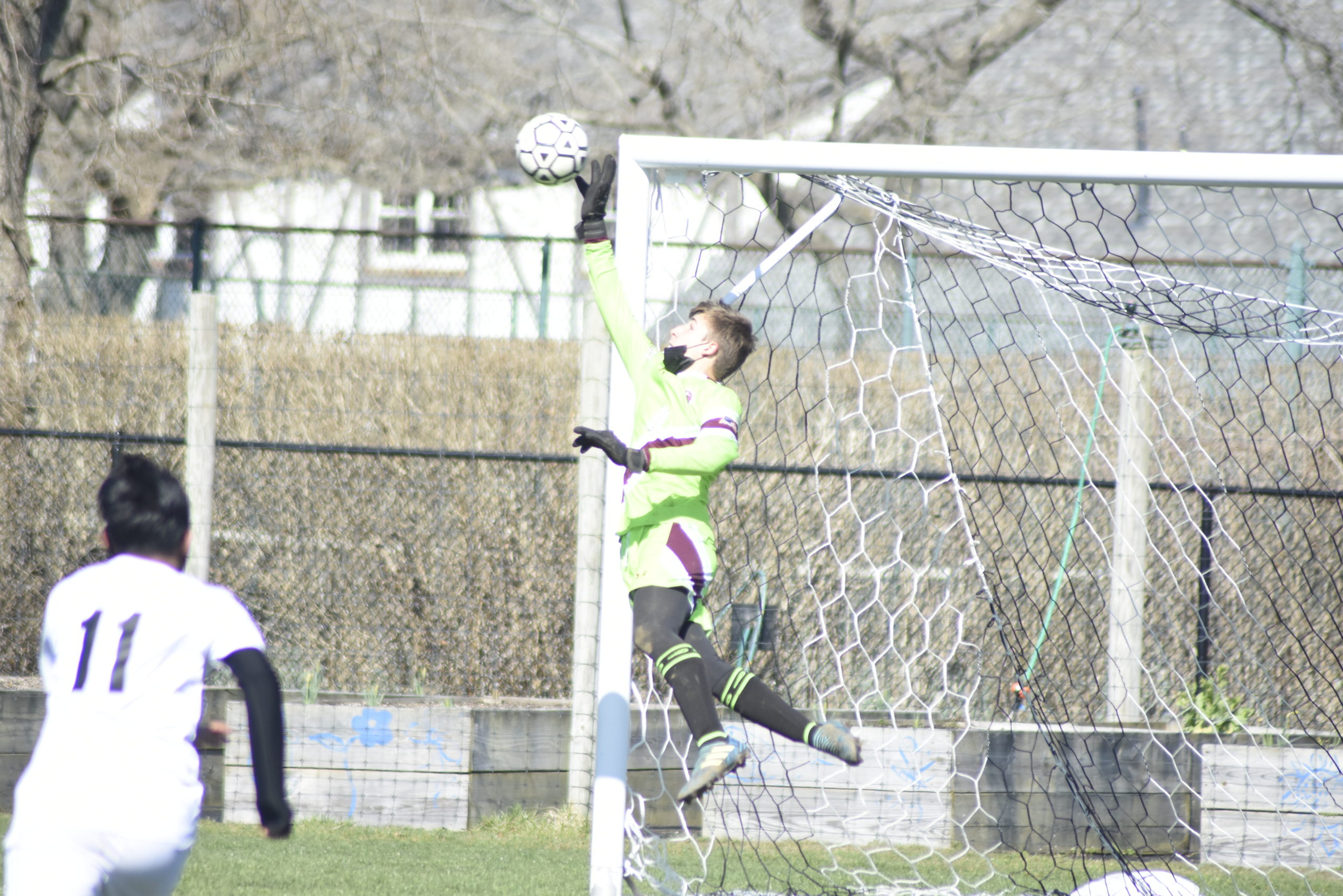 Southampton sophomore goalie Andrew Panza stretches out to make a save on Pierson's Javi Tubatan's indirect kick in the first half of Saturday's game.