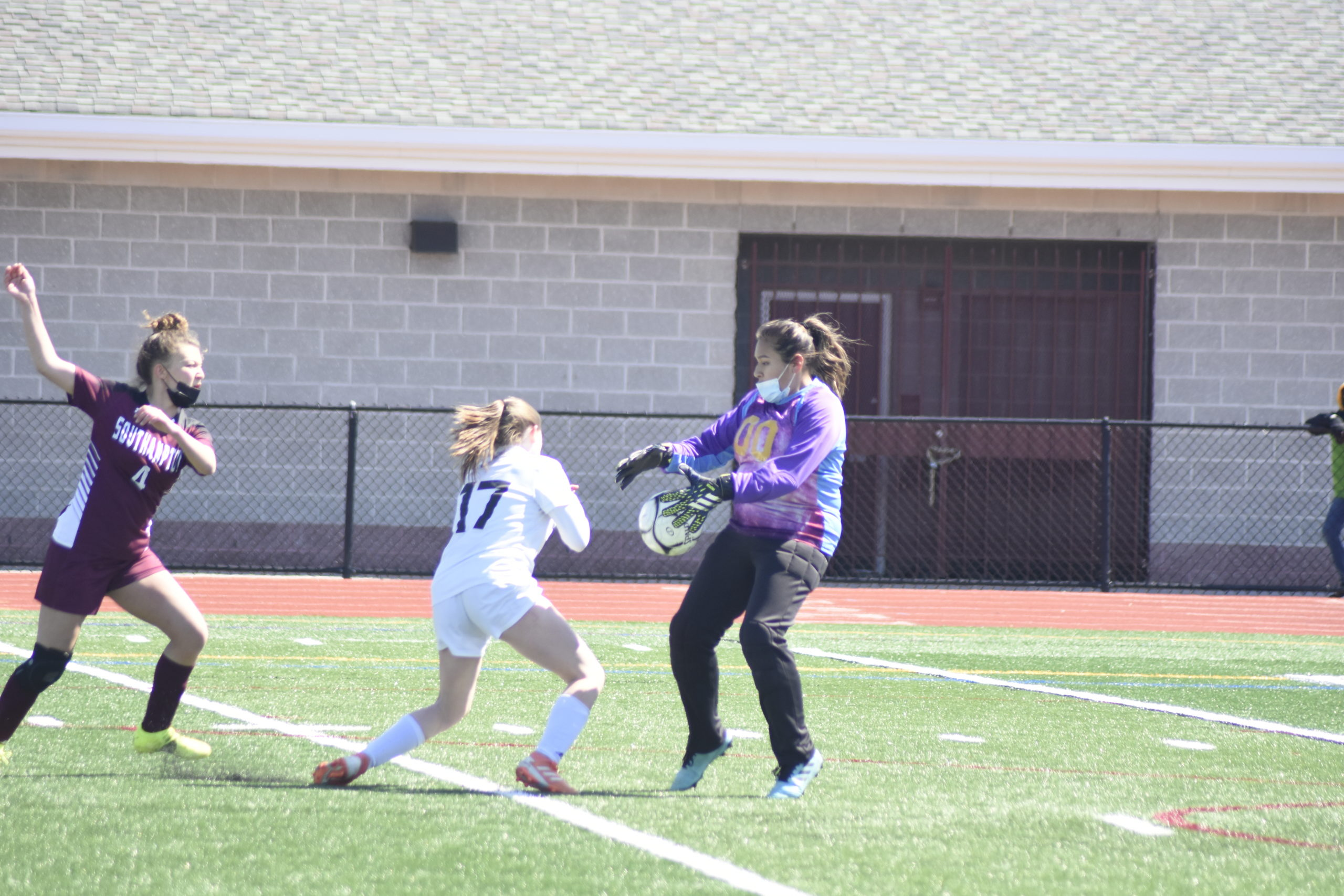 Southampton senior goalie Kendra Jimenez comes out to play a loose ball in the box before a Babylon player gets to it.