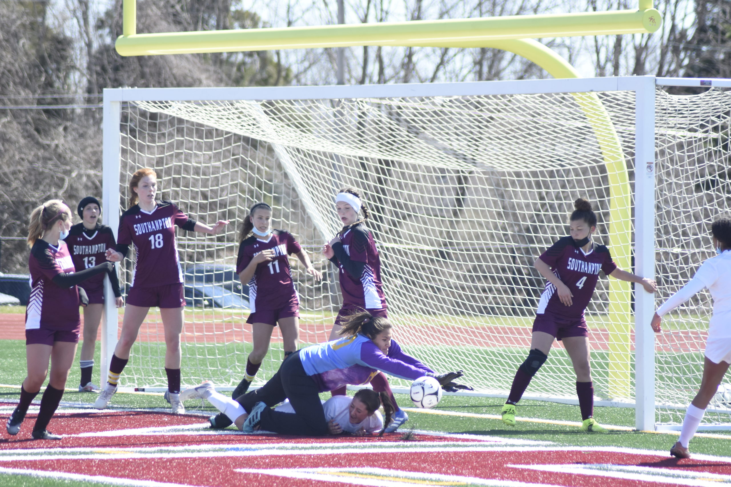 Kendra Jimenez leaps over a Babylon player to quash a corner kick try by the Panthers in the waning seconds of Saturday's game and preserve the 2-0 victory.