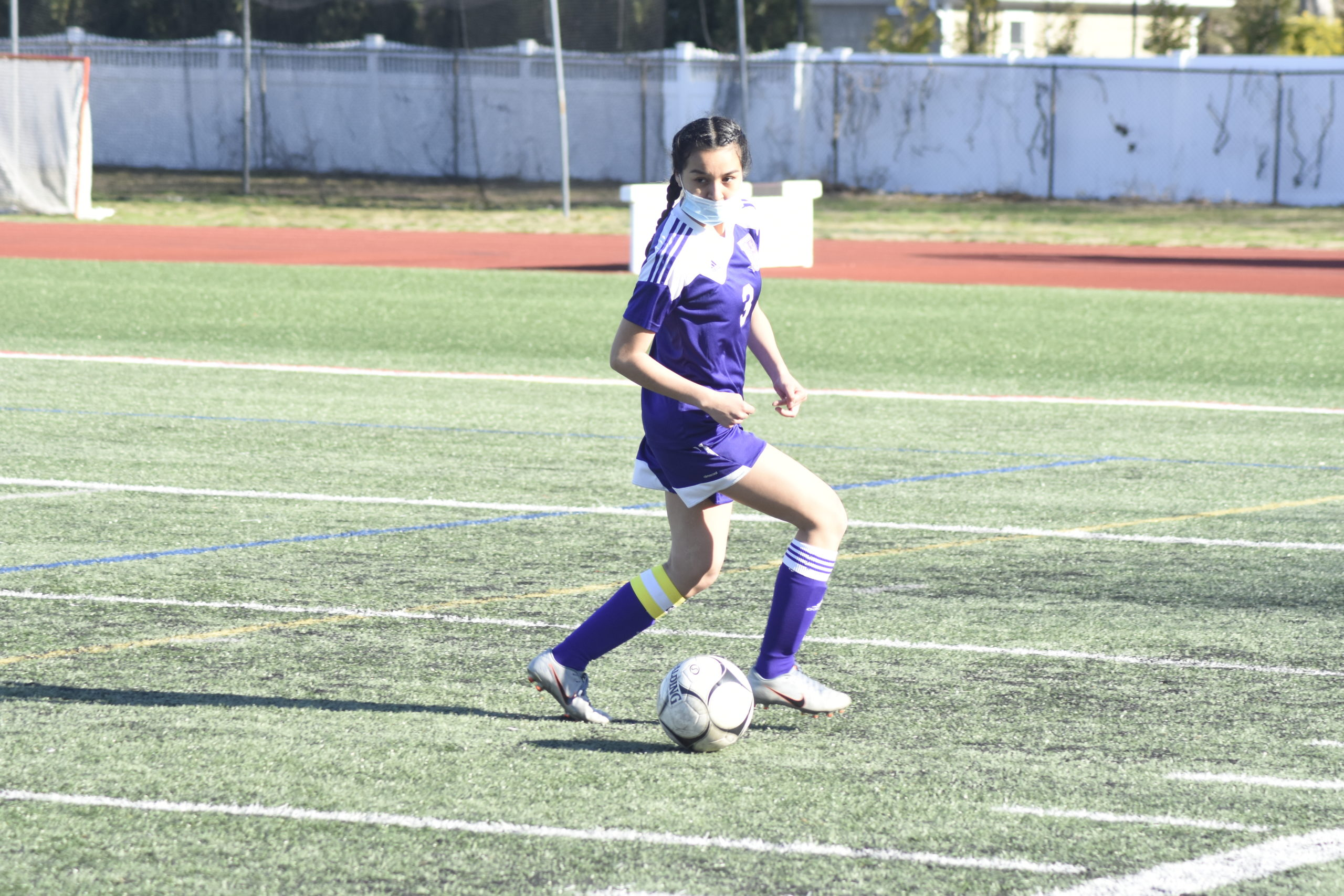 Hampton Bays senior tri-captain Jennifer Serna plays the ball deep in her team's defensive end.