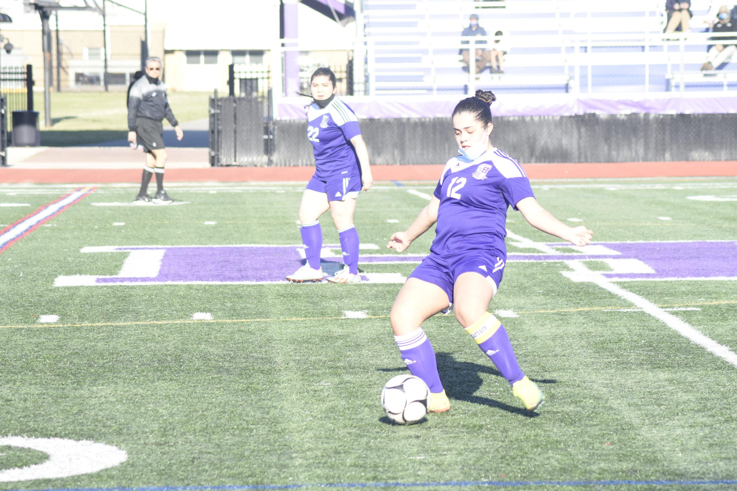 Hampton Bays senior tri-captain Stephanie Alvarez sends the ball upfield.
