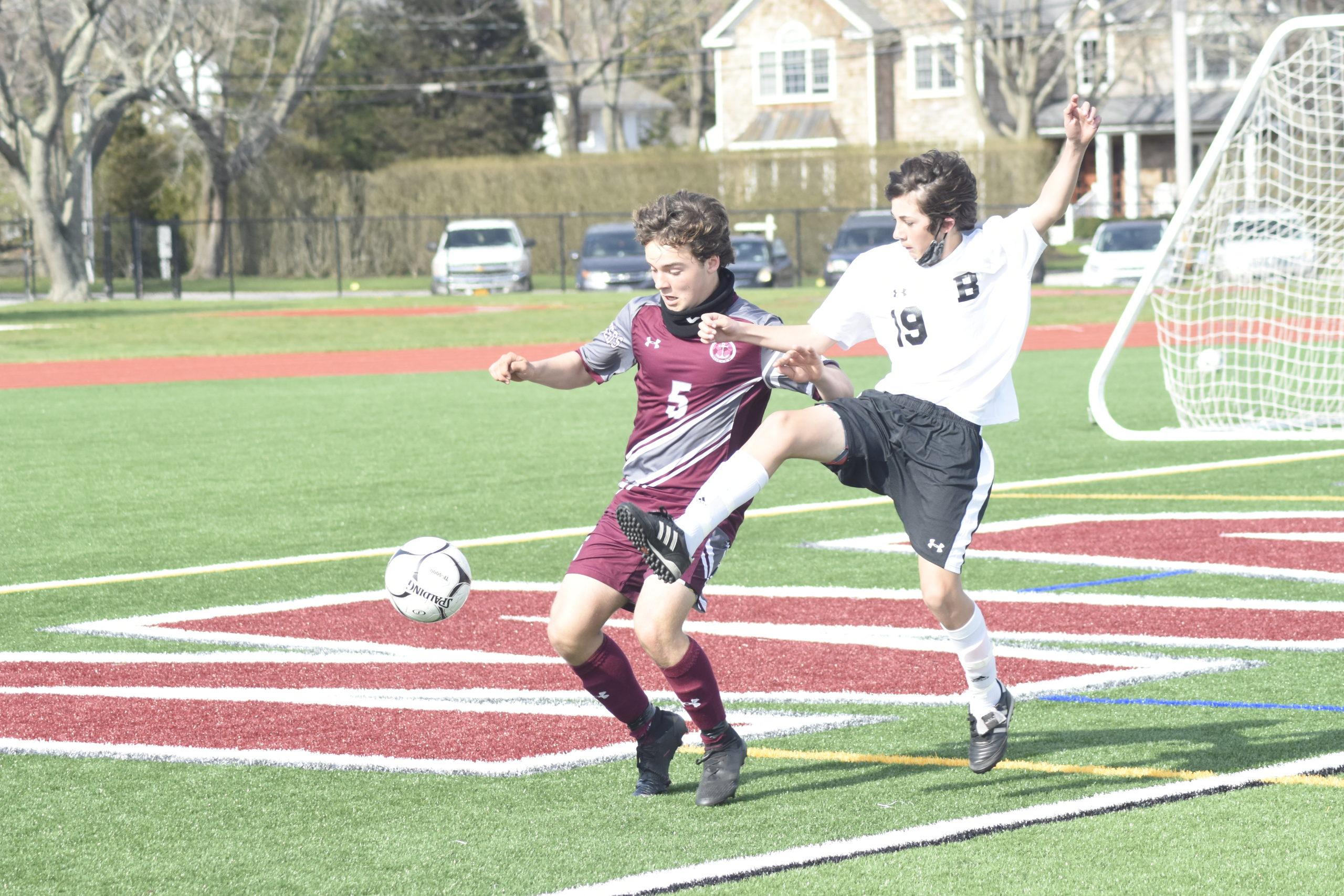 Southampton freshman Mason Stevens fends off Babylon eighth-grader Ciaran Stein.