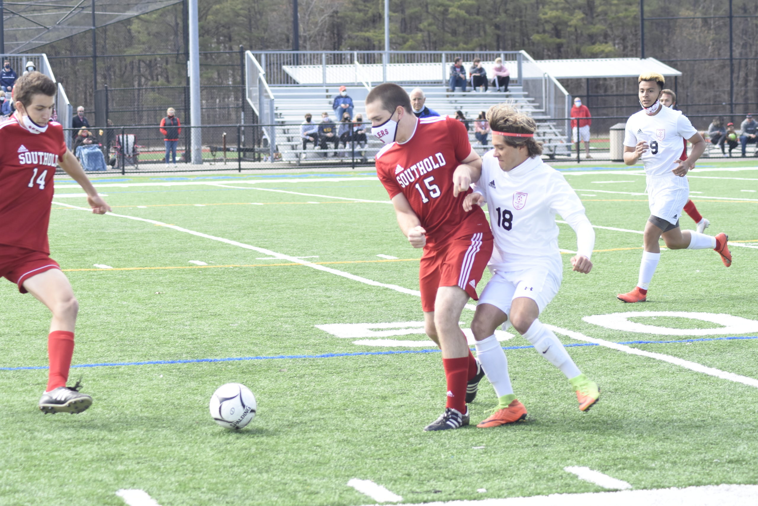 Southold junior Brendan Duffy screens Pierson senior Joey Badilla from getting to the ball.