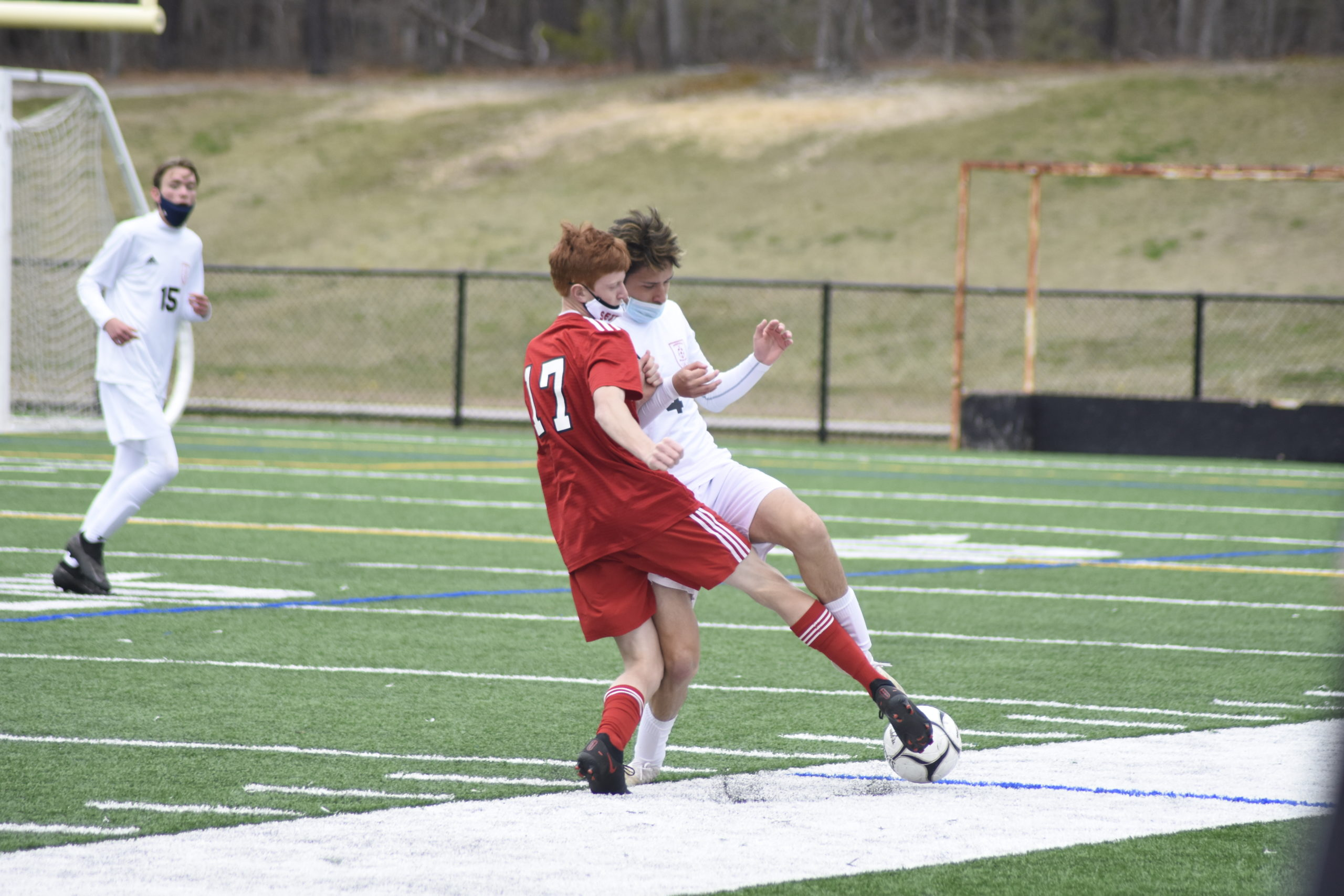 Pierson senior Richard Rodriguez tries to clear the ball but Southold junior Robert Guarriello blocks it.