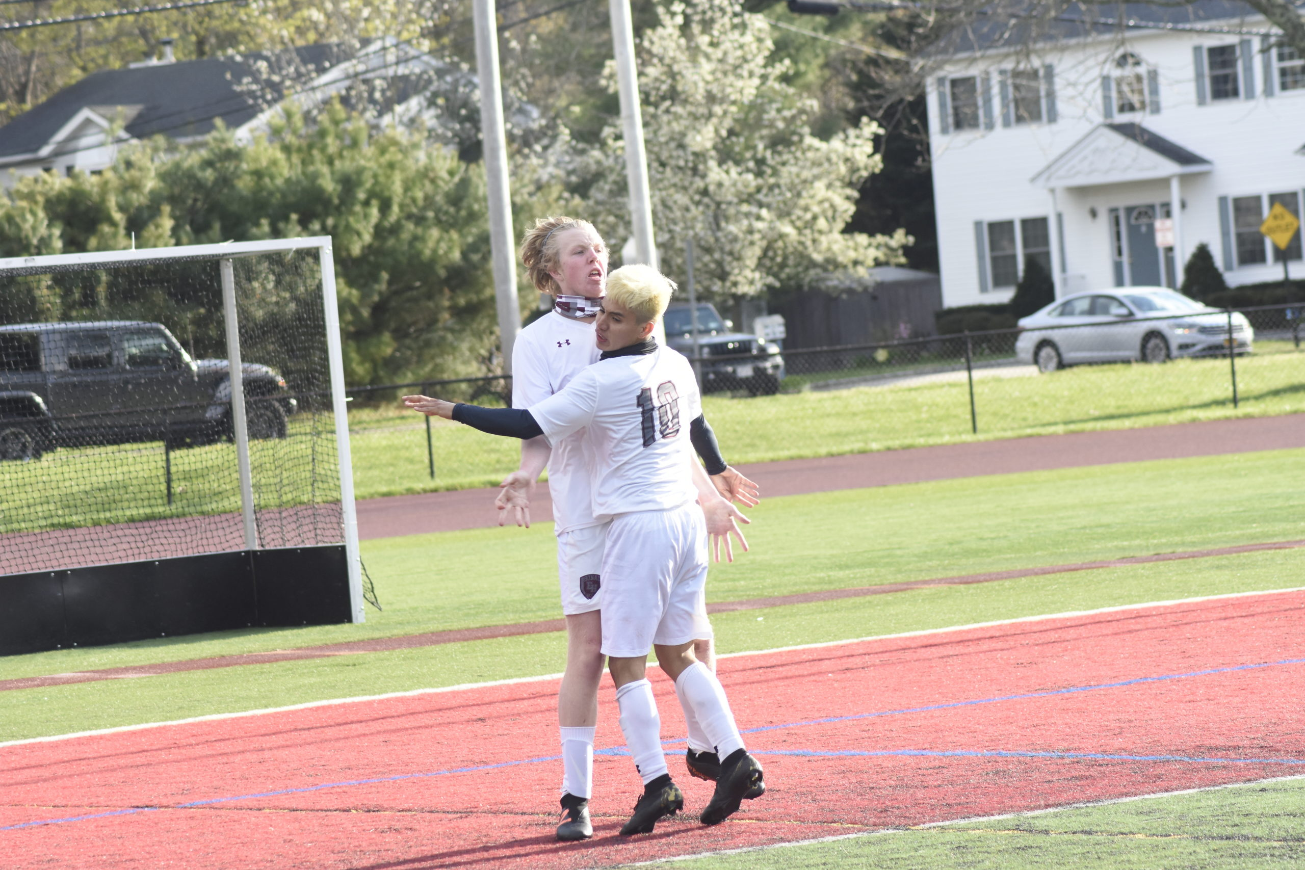 Matthew McGovern and Christopher Pintado embrace one another after McGovern's goal gave East Hampton a 3-0 lead in the Suffolk County Class A semifinal at Half Hollow Hills West. The Bonackers went on to upset Hills West, 5-1, to advance to Saturday's county championship.