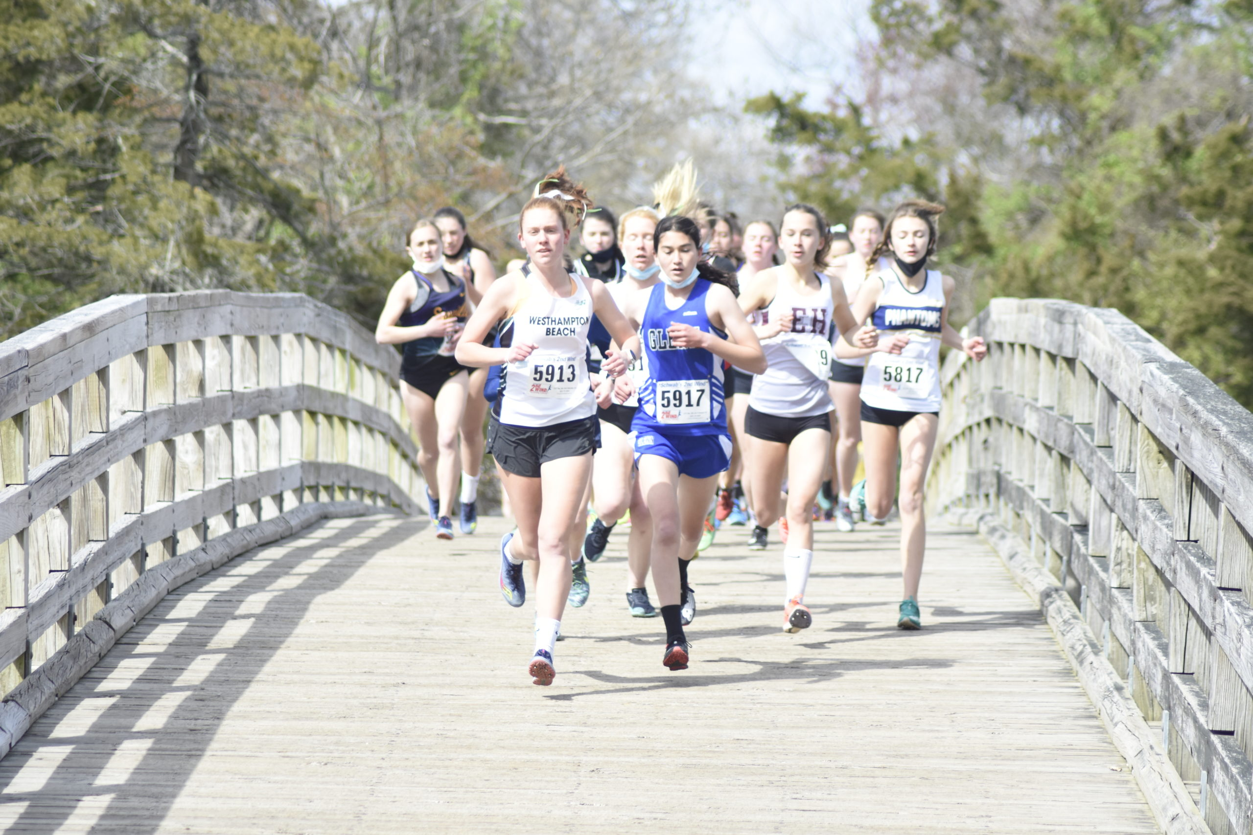 Westhampton Beach senior Jackie Amato leads the 'B' race over the bridge at the beginning of the course at Sunken Meadow.