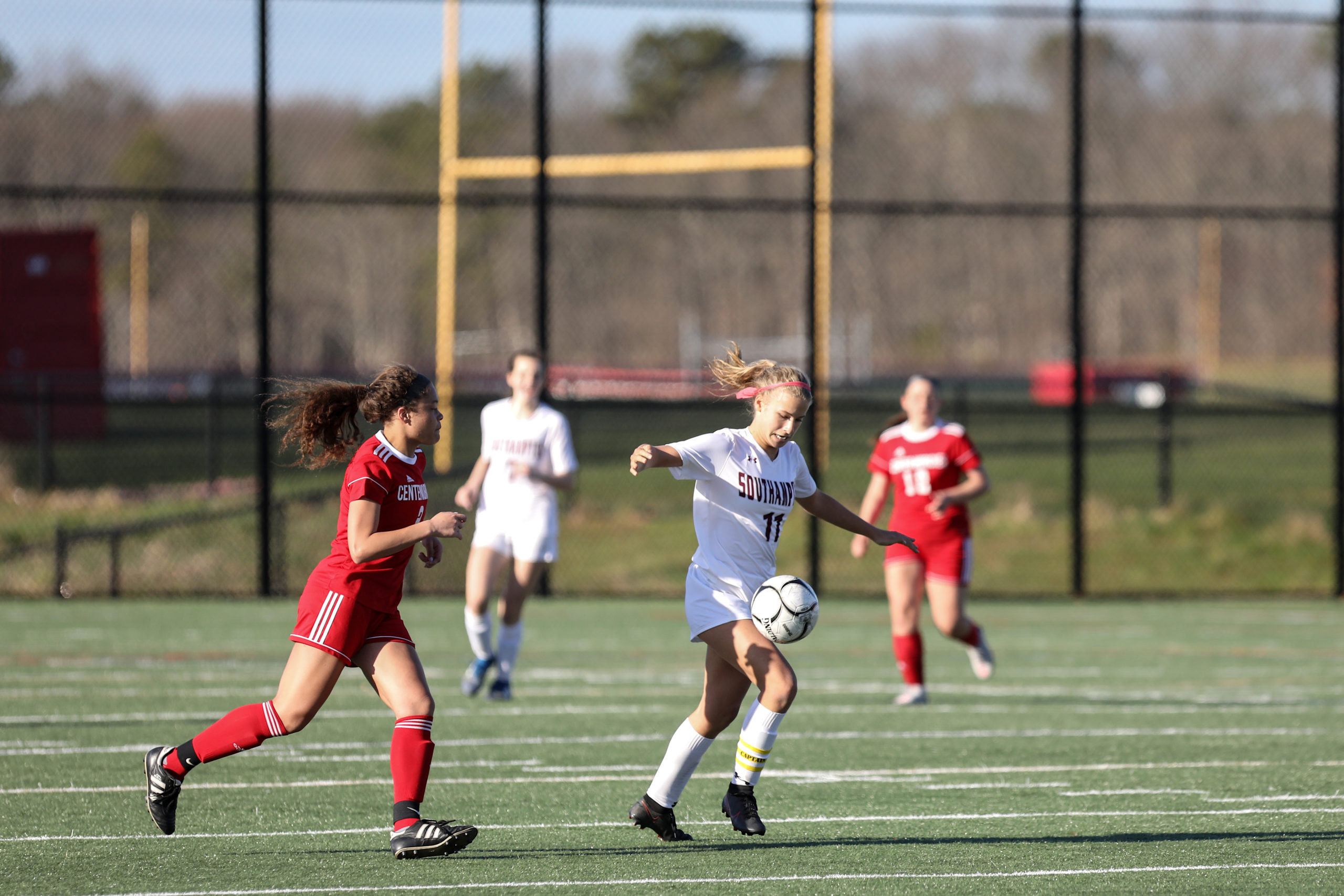 Southampton junior Charlotte Cardel carries the ball across the field.