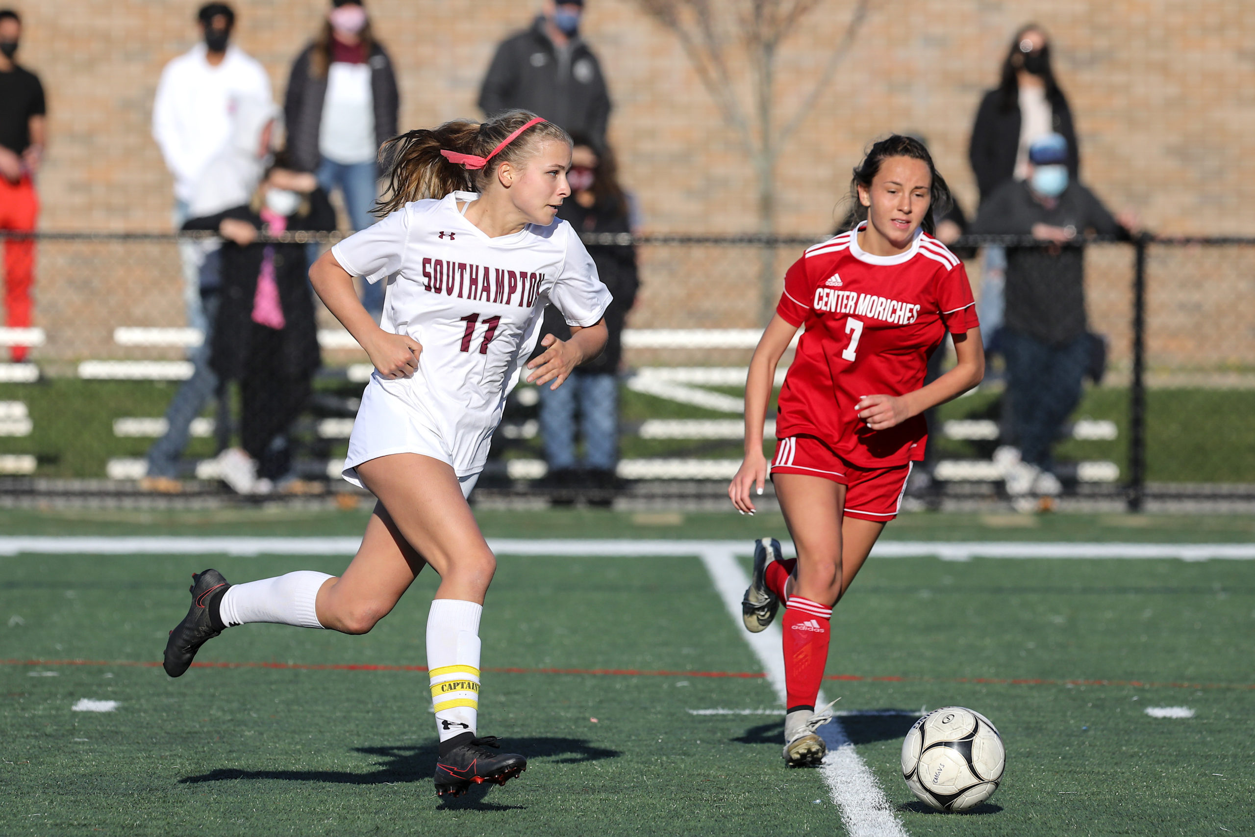 Southampton junior Charlotte Cardel dribbles the ball down the field.