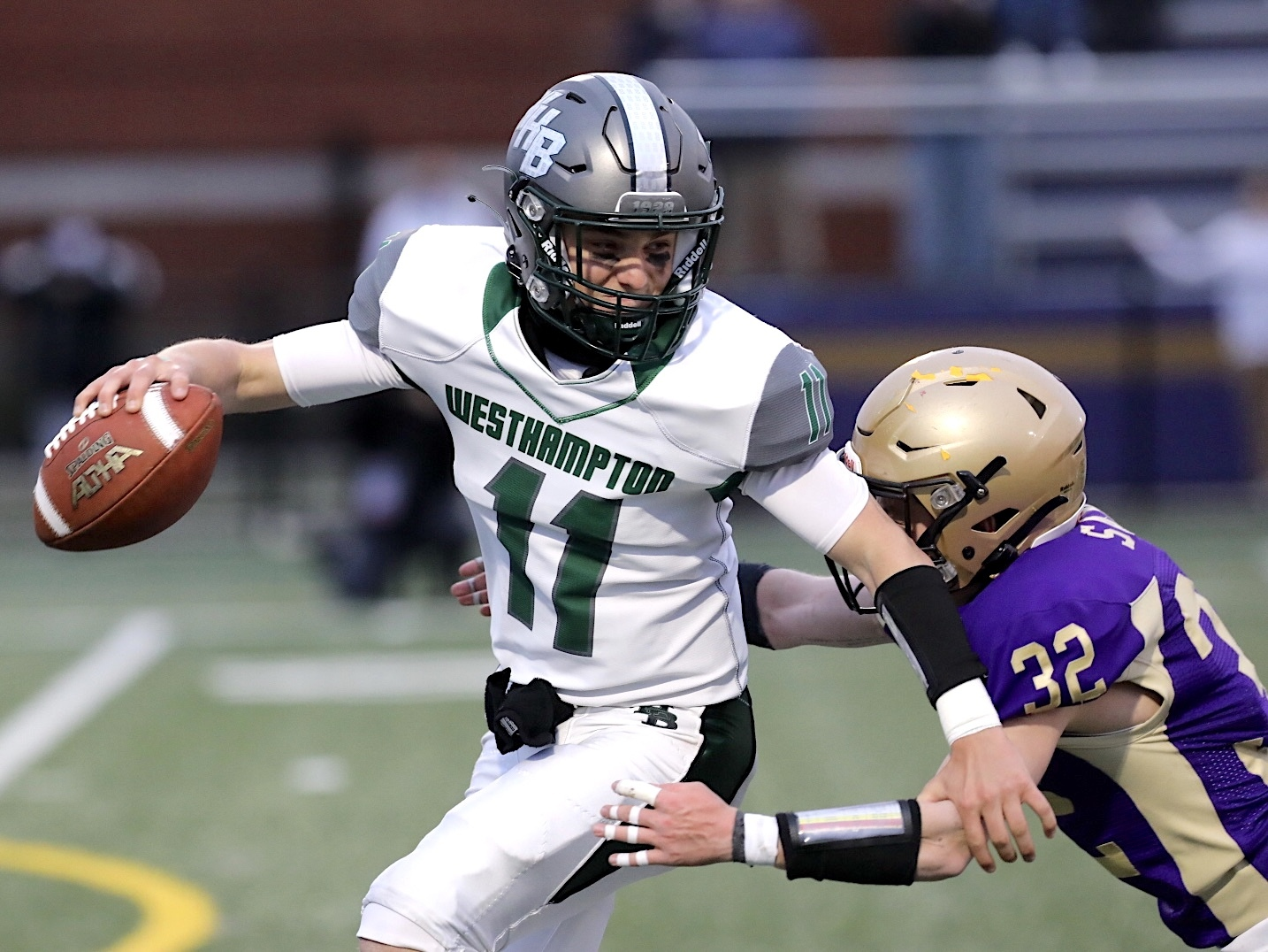 Westhampton Beach senior quarterback Christian Capuano attempts to make a play while evading Sayville's Charlie Sands.