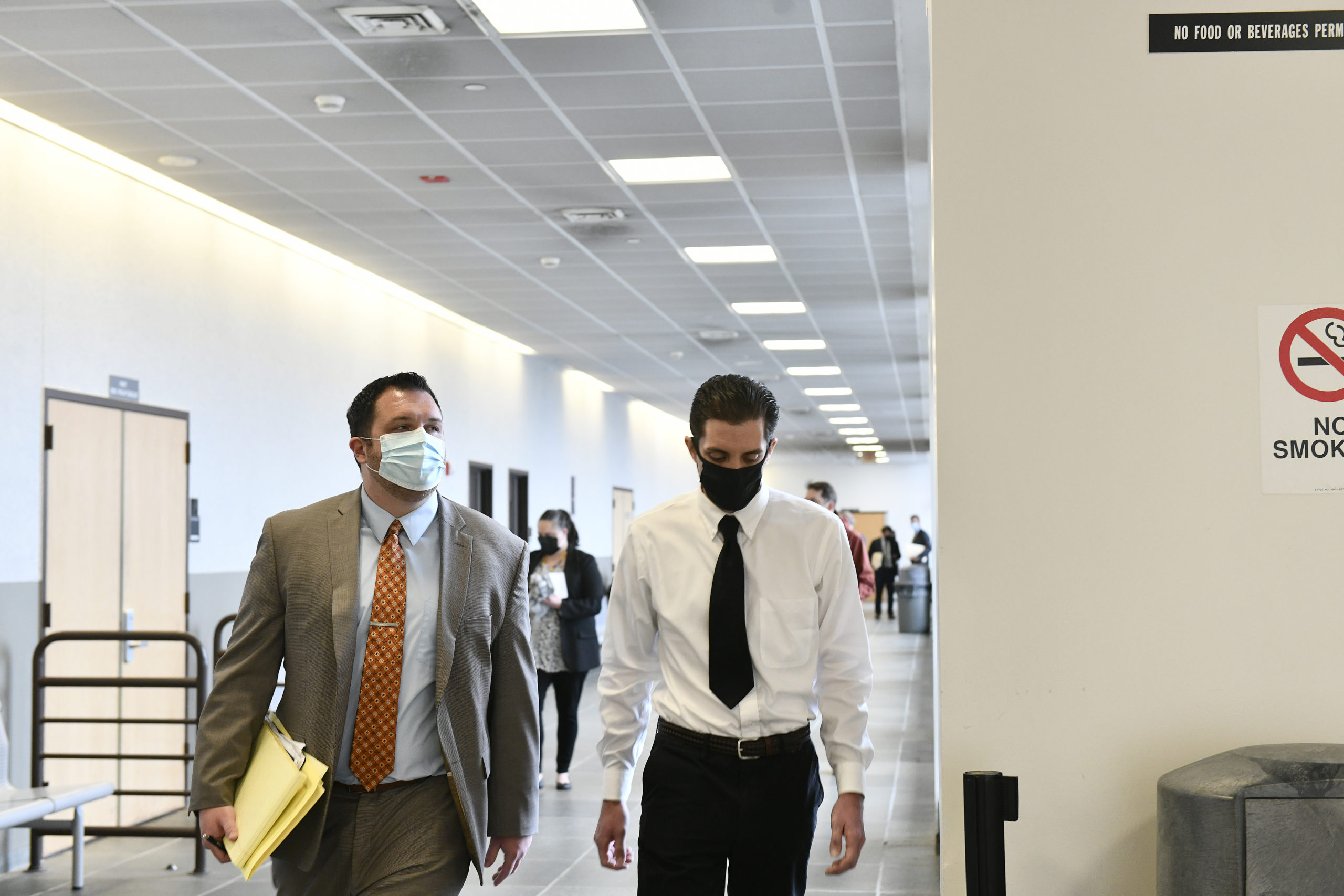 Mark A. Corrado, right, leaves the courtroom with his attorney on Thursday.  DANA SHAW