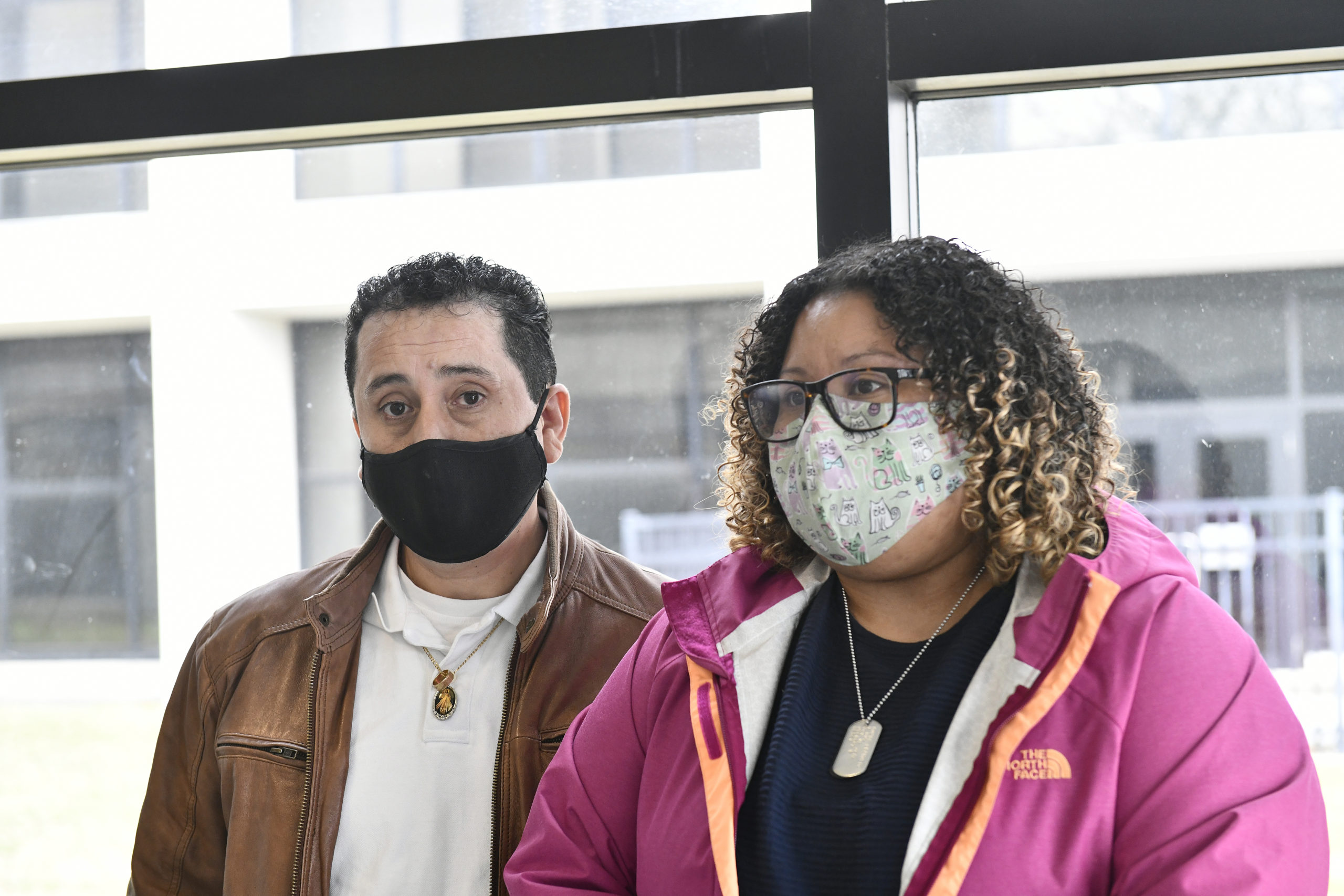 Wilson Murillo, the husband of Yuris Murillo-Cruz with family friend Angelica Marta at the Suffolk County Court on Thursday.   DANA SHAW