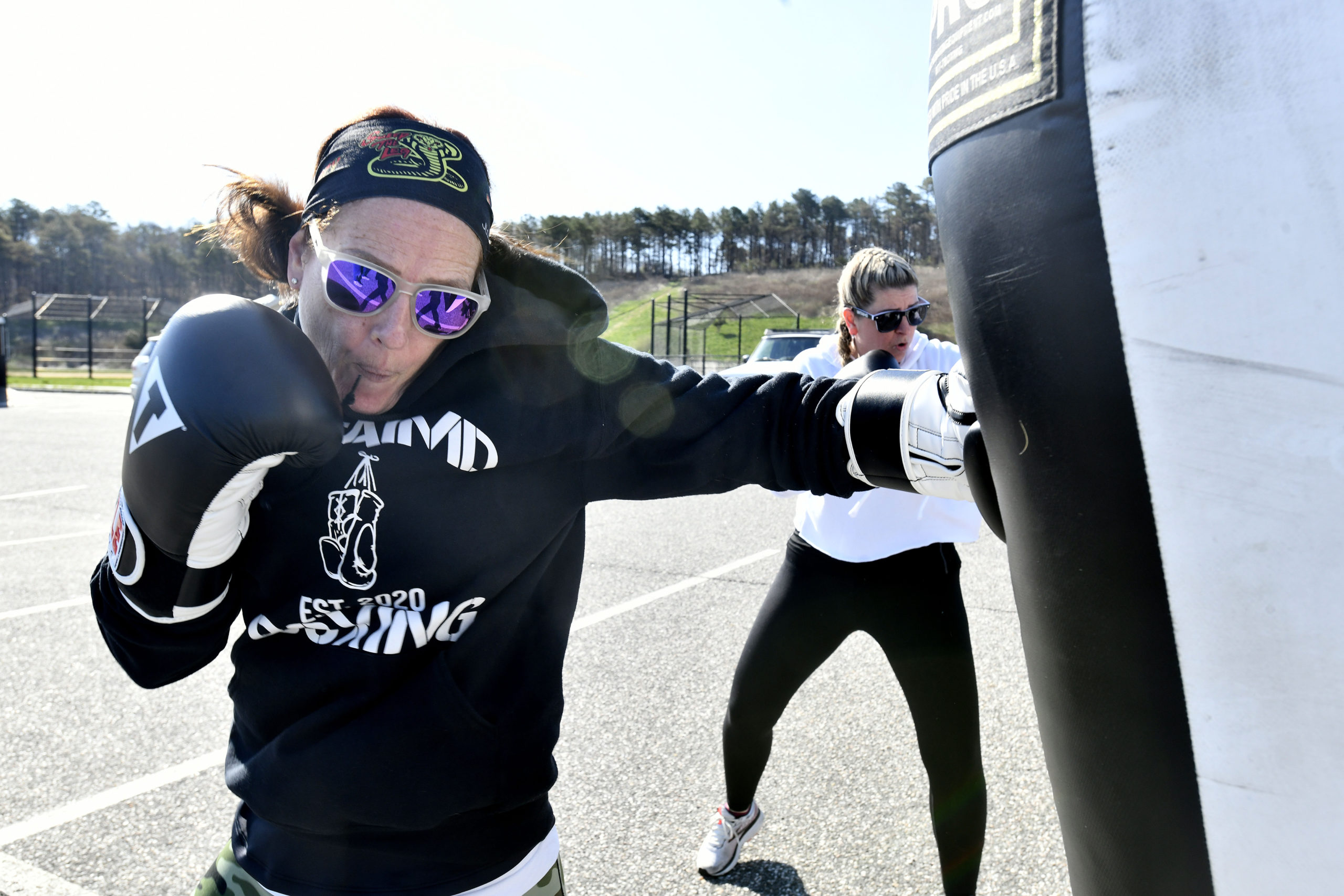 Katie Knoebel works out at  Untaimd Fitness at the SYS parking lot.   DANA SHAW