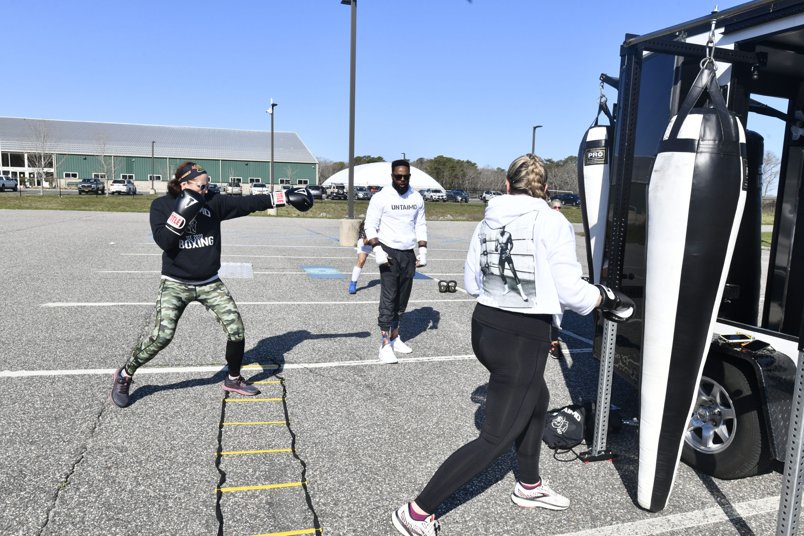 The class at Untaimd Fitness in the SYS parking lot on Monday.  DANA SHAW