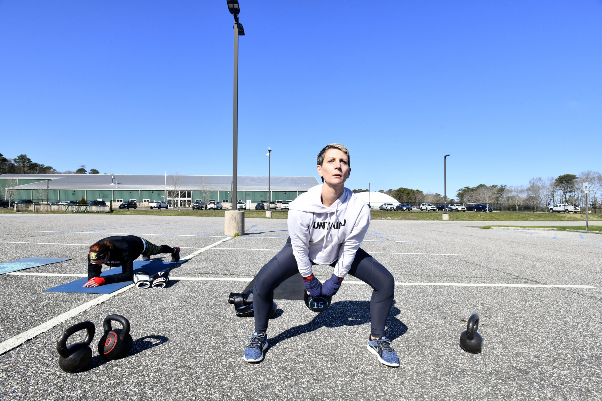 Mica Berg works out with a kettle bell at Untaimd Fitness on Monday.  DANA SHAW