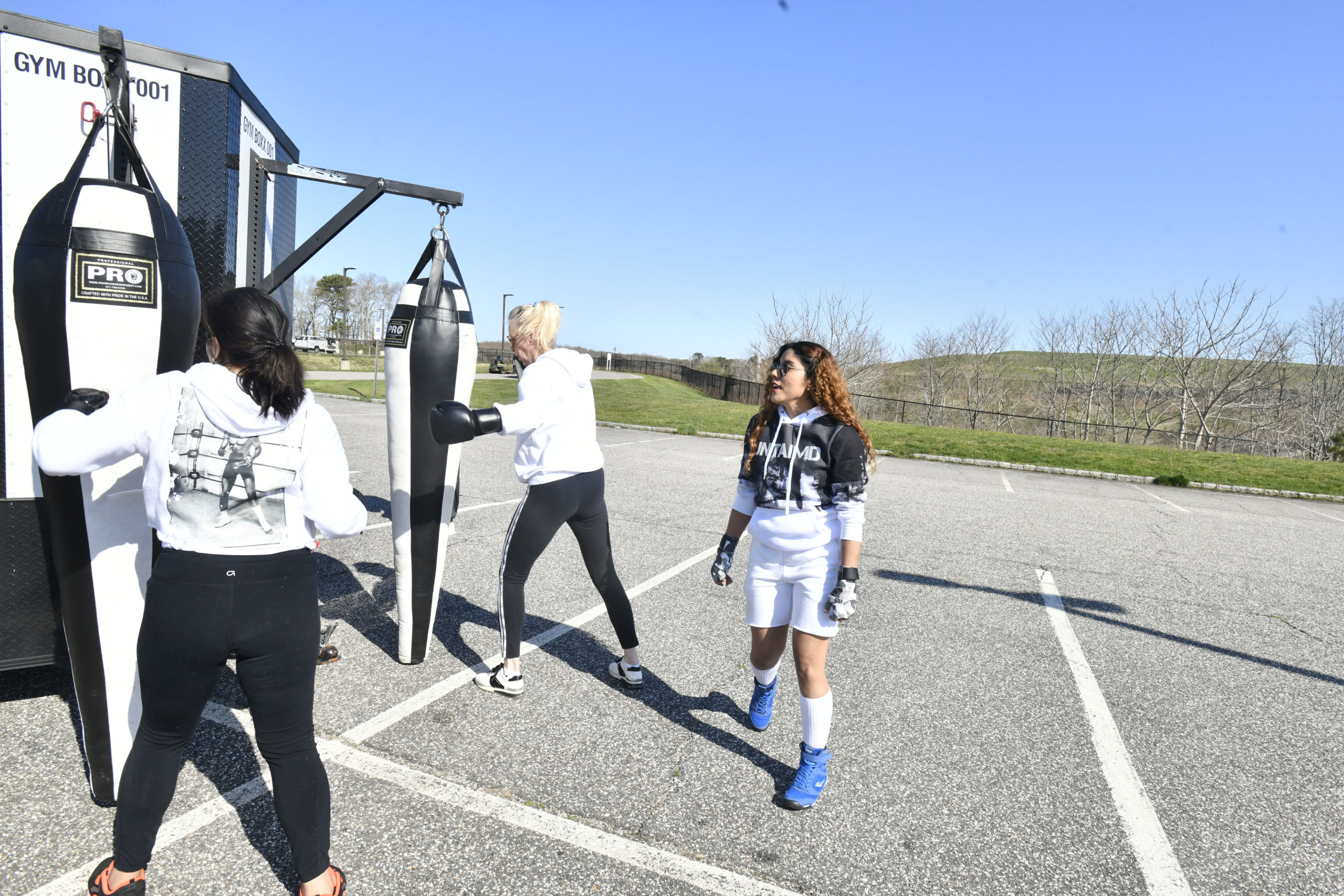 Instructor Camy Agudelo woks with students at Untaimd Fitness on Monday.  DNAA SHAW