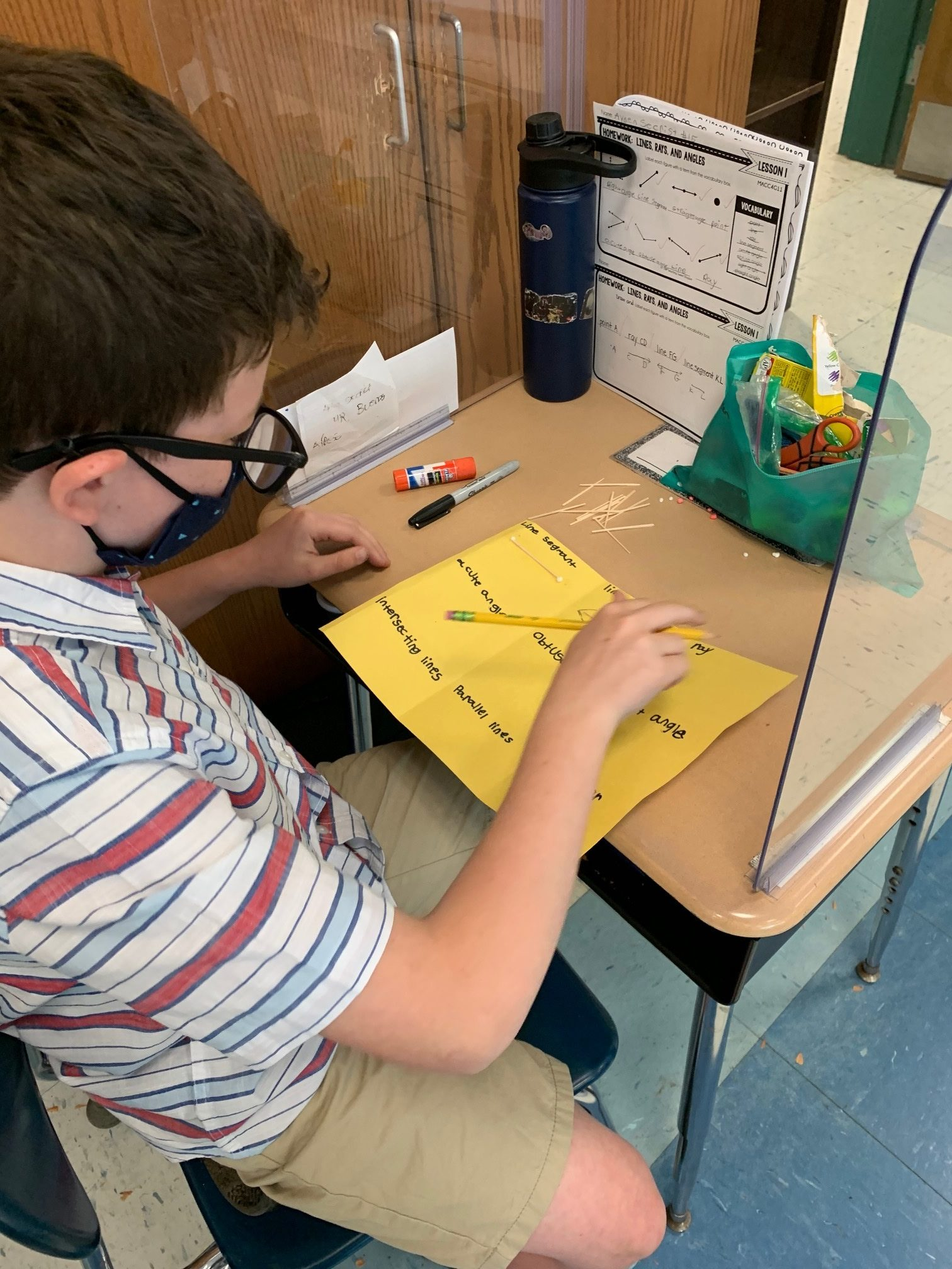 East Quogue Elementary Student Ayden Secrist creates an interactive word wall of geometry vocabulary last week. Students practiced new words by building the word.