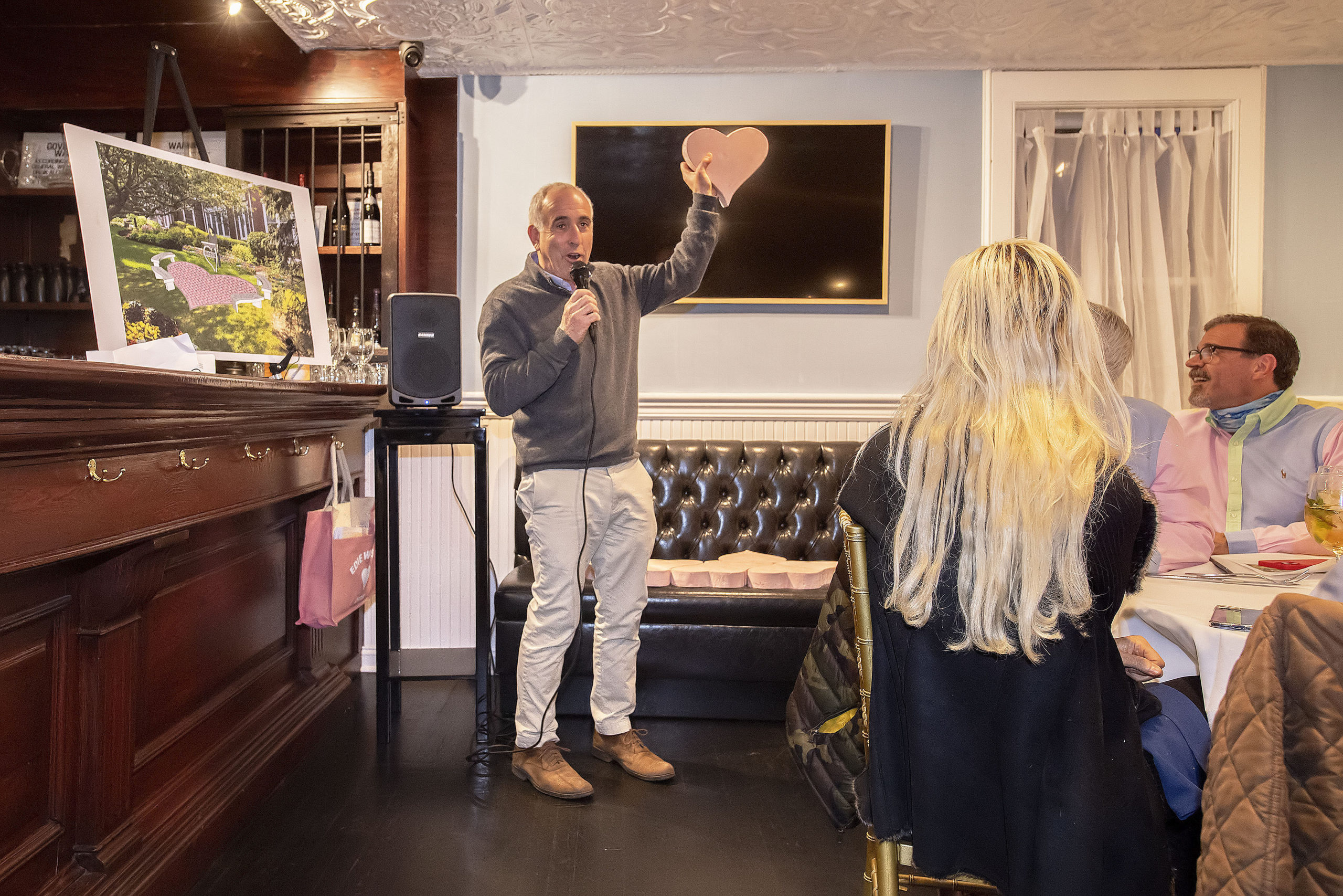 Southampton Town Supervisor Jay Schneiderman introduces announces the Edie Windsor Heart at Southampton Town Hall during a ceremony at the Union Steak & Sushi restaurant in Southampton on Thursday, April 22.   MICHAEL HELLER