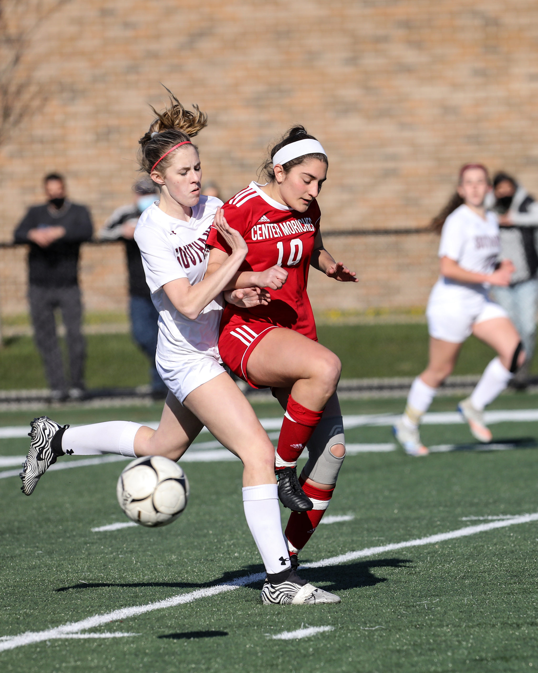 Southampton sophomore Emily Zukosky battles for the loose ball.