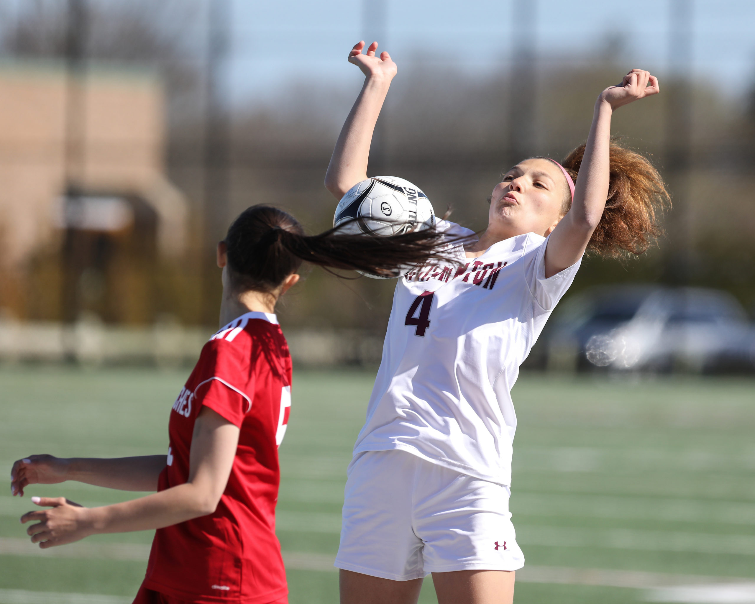 Southampton junior Gabriella Arnold uses her body to keep the ball in play.