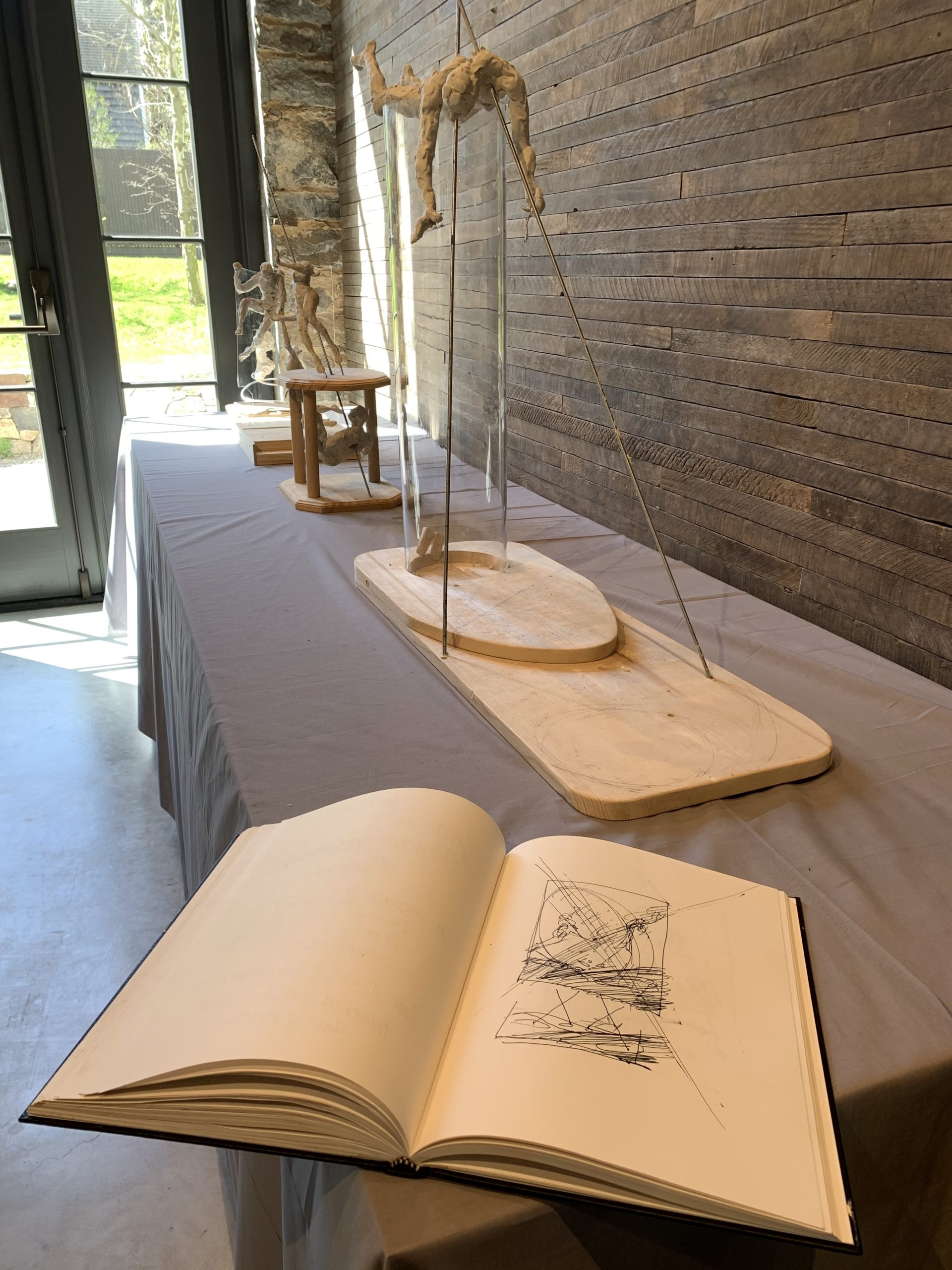 Jim Gingerich's sketchbook and a sculpture.