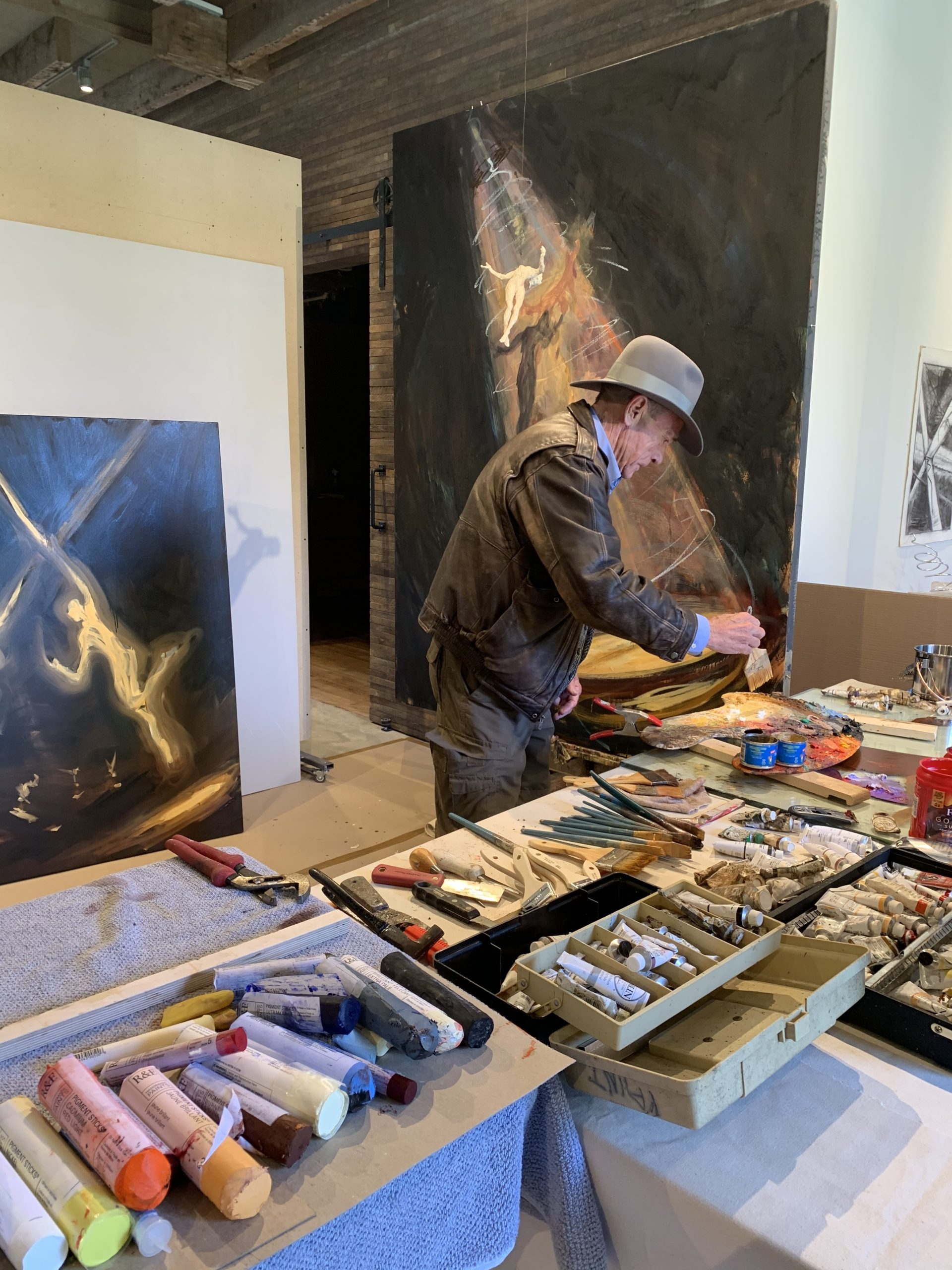 Jim Ginerich at work on a painting.