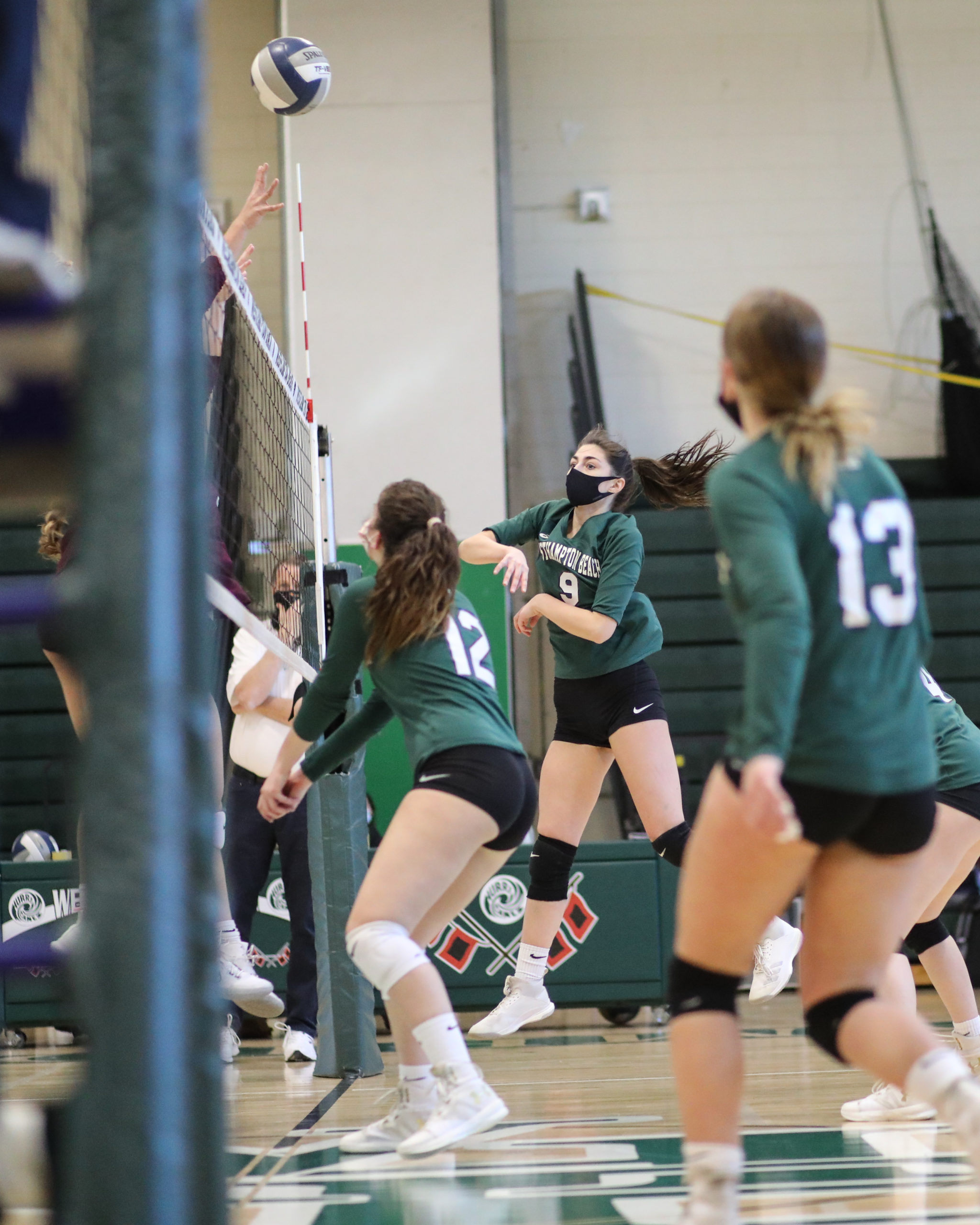 Westhampton Beach senior Jackie Glaser spikes the ball over the net.