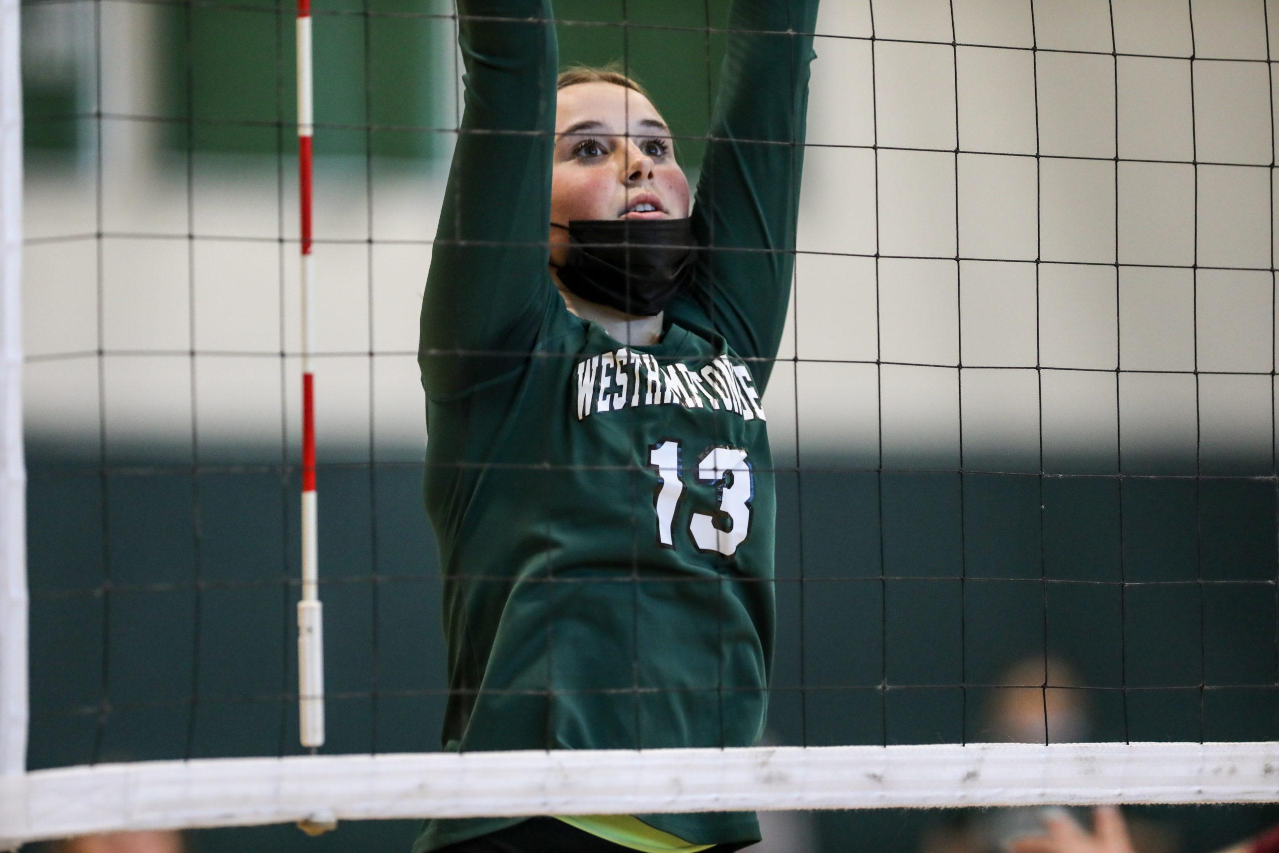 Westhampton Beach sophomore Lauren Goss reaches for a block.
