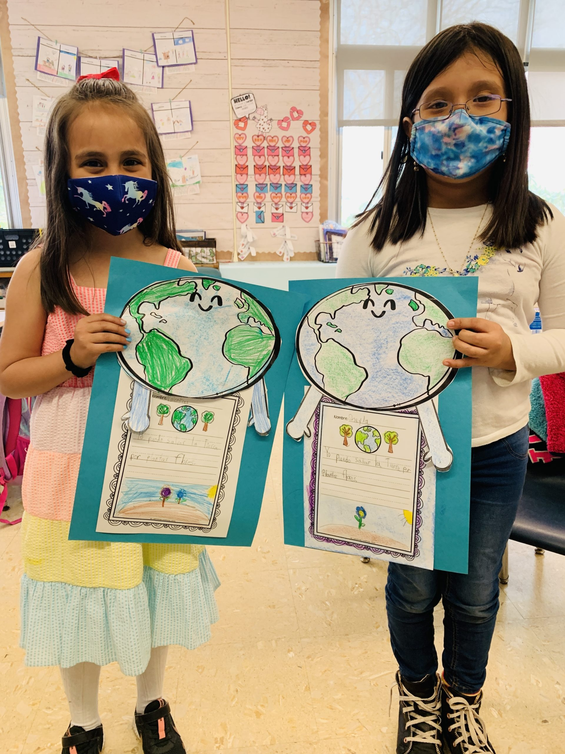 Hampton Bays Elementary School students show off their Earth Day art.