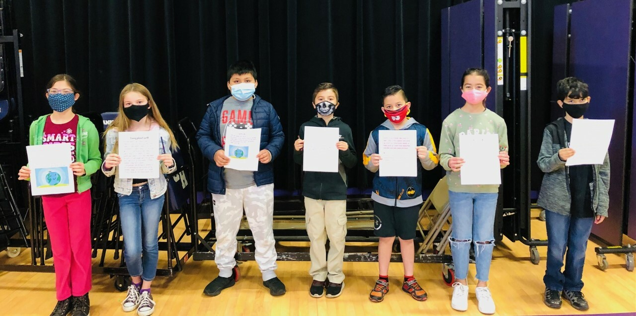Fourth graders Emmanuel DaSilva, Sebastian Giraldo-Ortiz, Charlie Hewes, Jake Mijangos, Ithan Quiguiri, Juliana Ruiz and Isabella Santamaria won the Earth Day writing contest for their grade.