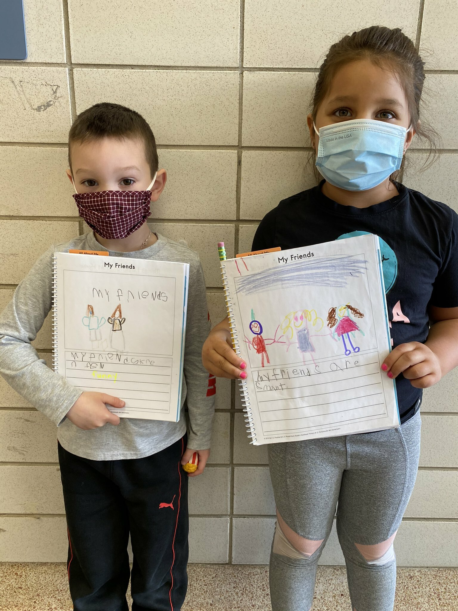 Morgan Tiska's kindergarten class at Hampton Bays Elementary School practiced their literary skills recently by writing about the friends they have made this school year. They also drew colorful images to accompany their work.
