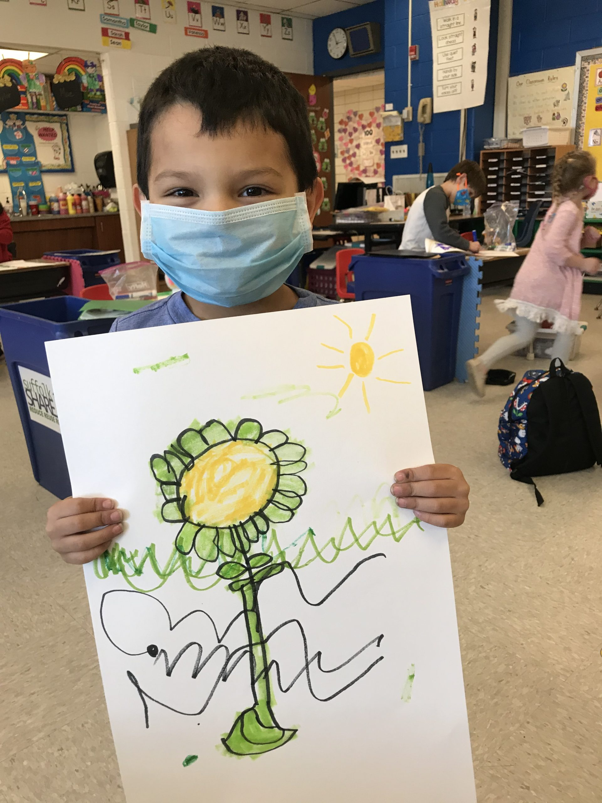 """June Eaton's class at Hampton Bays Elementary School learned more about the life cycle of plants through a variety of activities. Following a reading of """"The Tiny Seed"""" by Eric Carle, the students watched science videos on plants, illustrated and labeled plant parts such as the roots, stems, leaves and flowers, created """"word flowers"""" that featured newly learned vocabulary, and planted their very own seeds."""