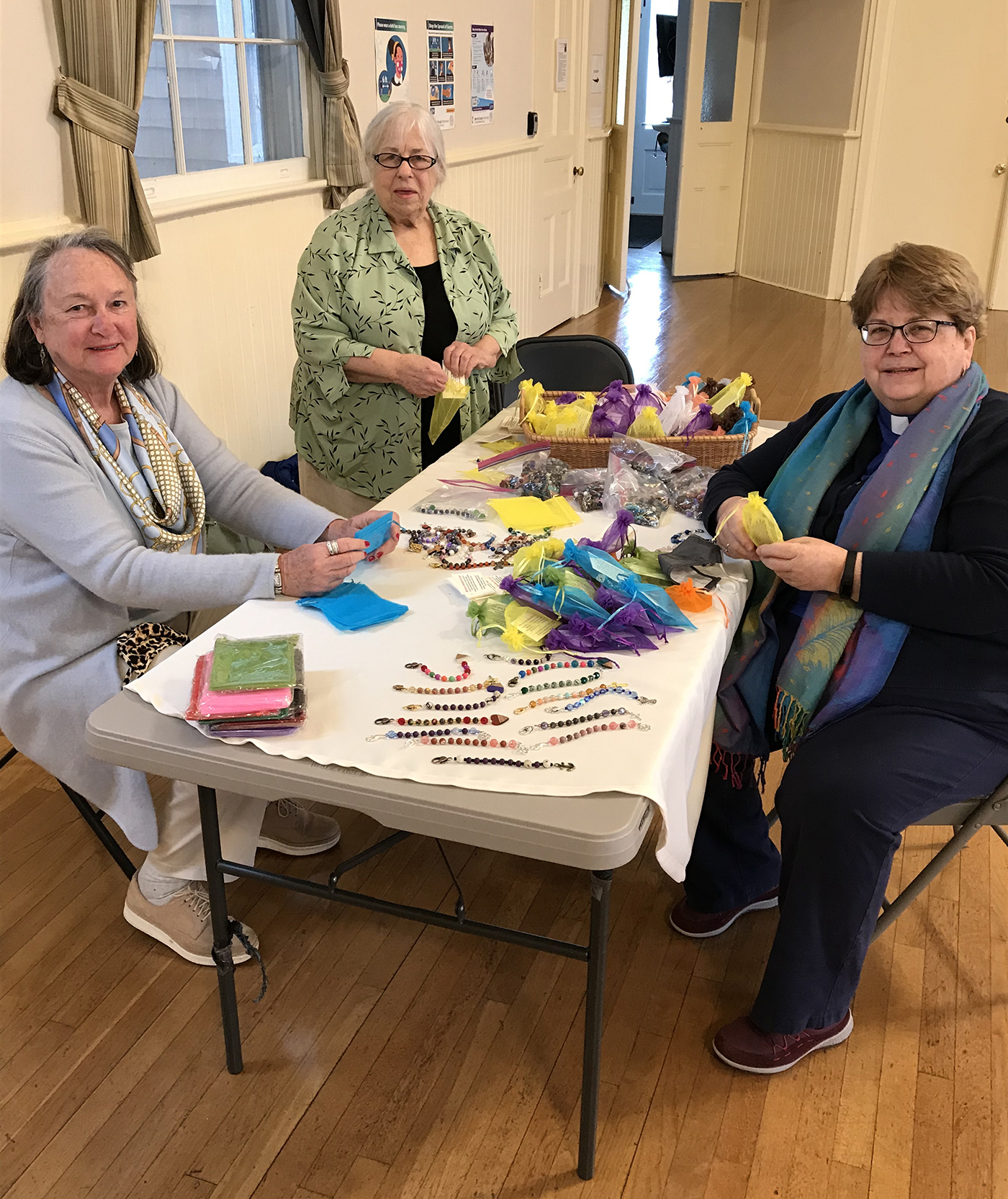 Carol Gilbert, from left, Dorothy Wienecke, and Rev. Joanne Utley package some of the 700 strands of prayer beads made by Hamptons United Methodist Church.