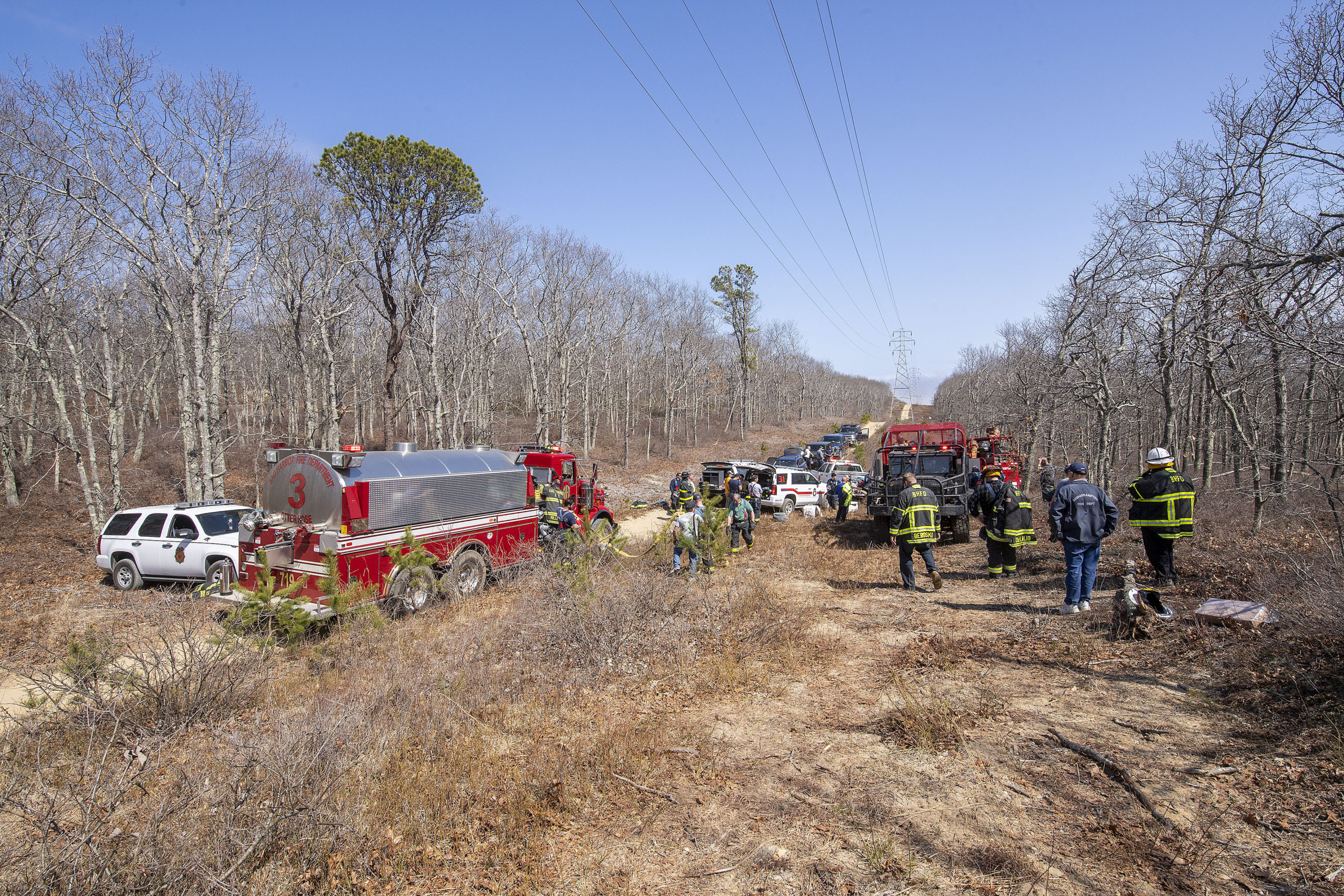 The brush fire was deep in the woods near the power lines.