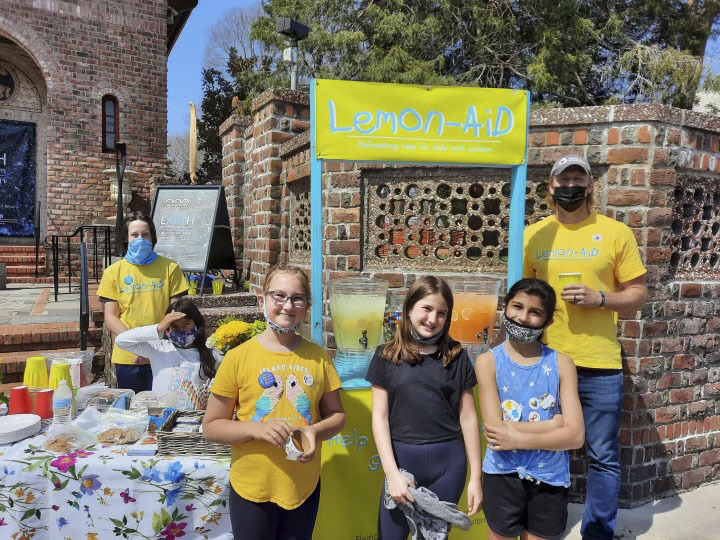 Students in Nick Epley's after school service club spent part of their Saturday raising money for the Flying Point Foundation for Autism by volunteering to run its Lemon-AID stand outside the Southampton Arts Center.