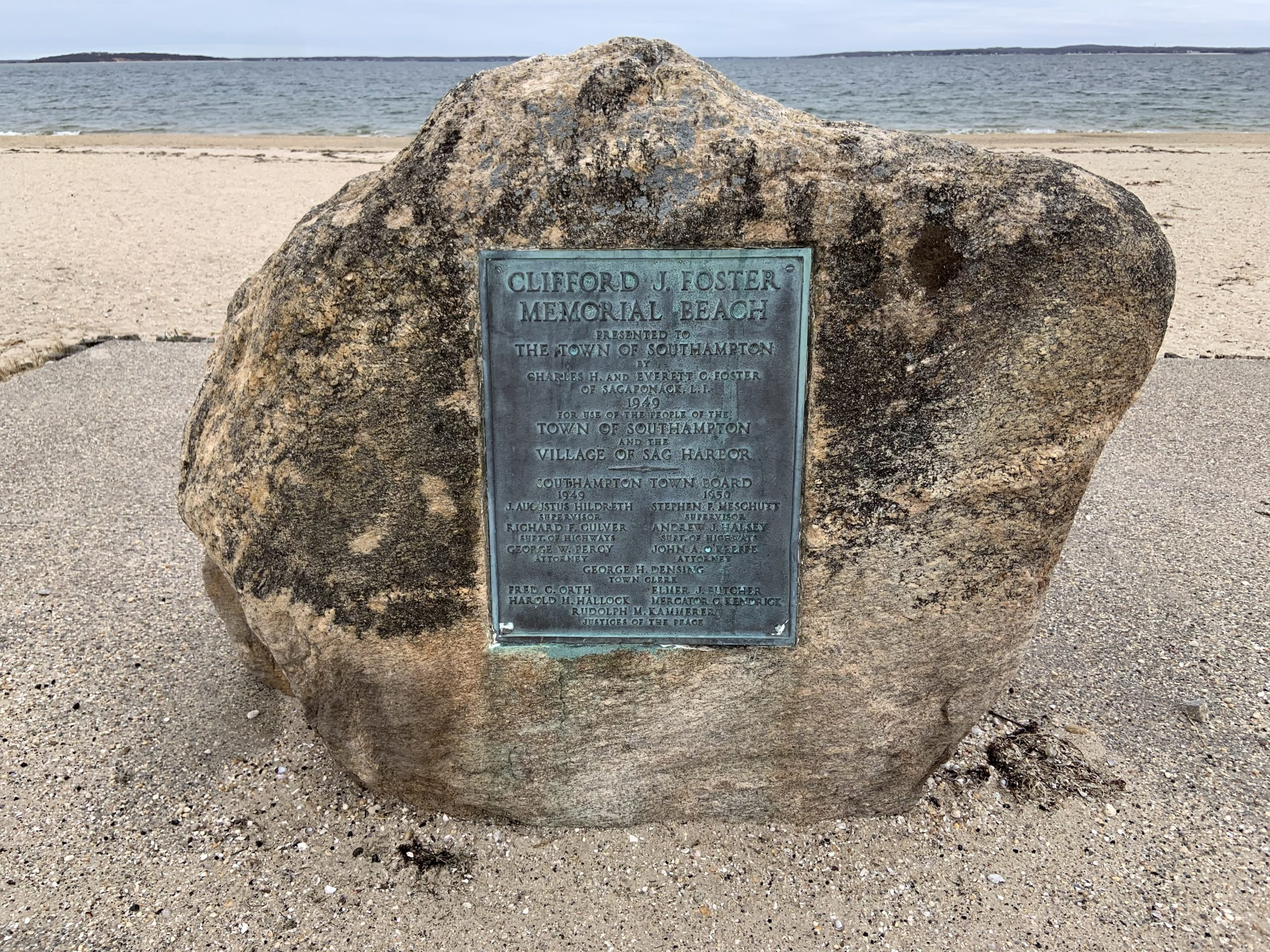 A plaque dedicating Clifford J. Foster Memorial Beach to the residents of both Southampton Town and Sag Harbor Village is placed at what is commonly called Long Beach.  Stephen J. Kotz