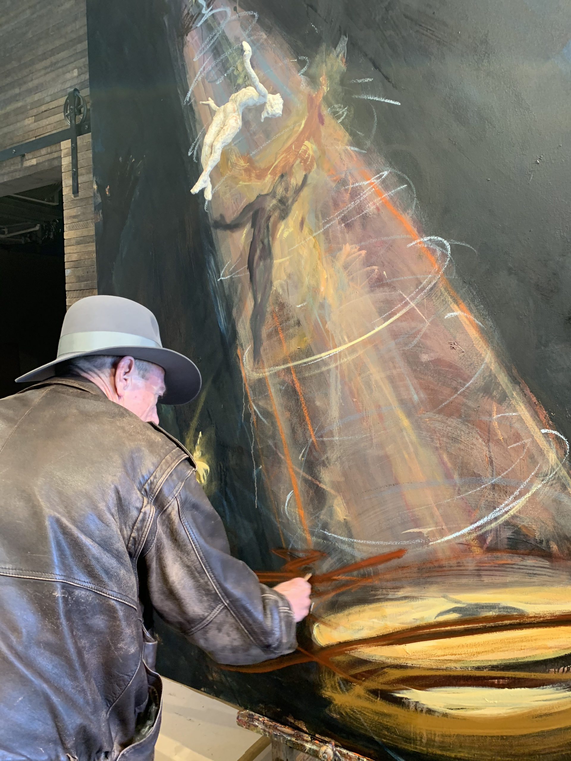 Jim Gingerich at work on a painting in The Church.