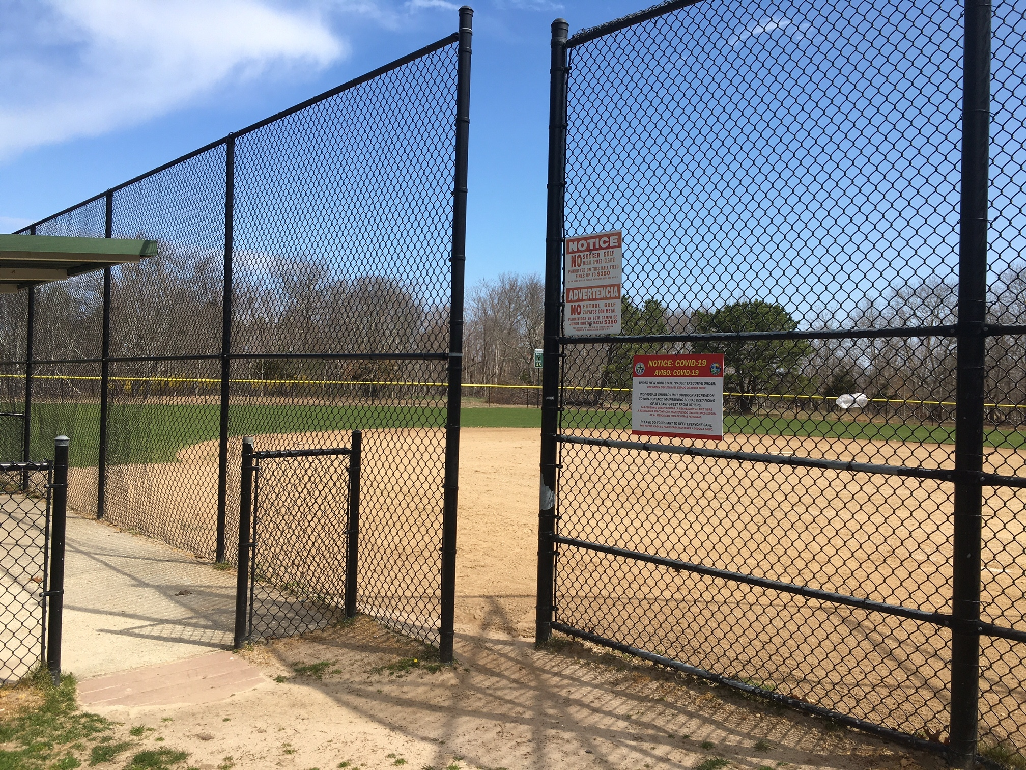 On a sunny spring Saturday, the ballfield at Iron Point Park is empty.