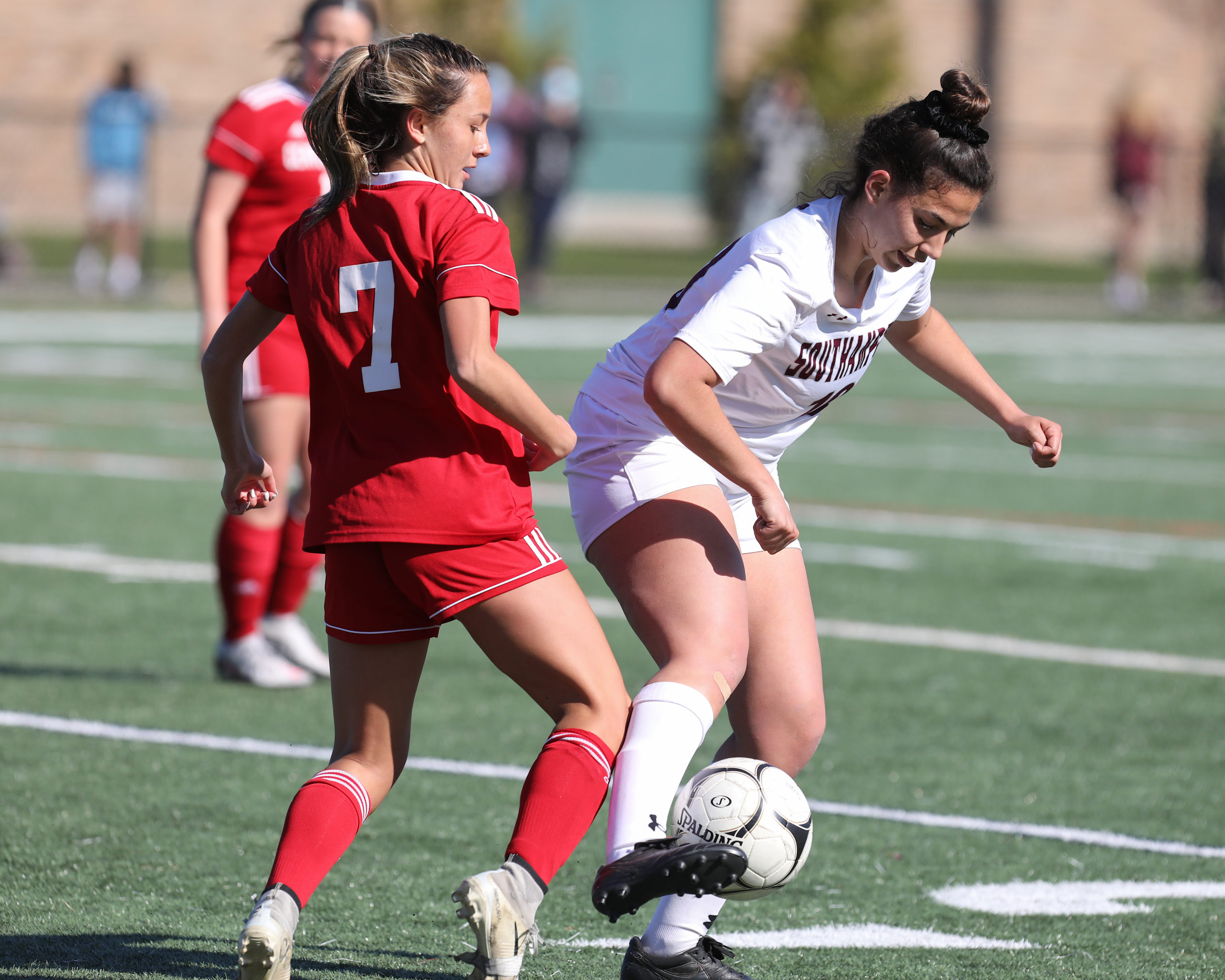 Southampton junior Isabelle Palumbo keeps Center Moriches away from the ball.