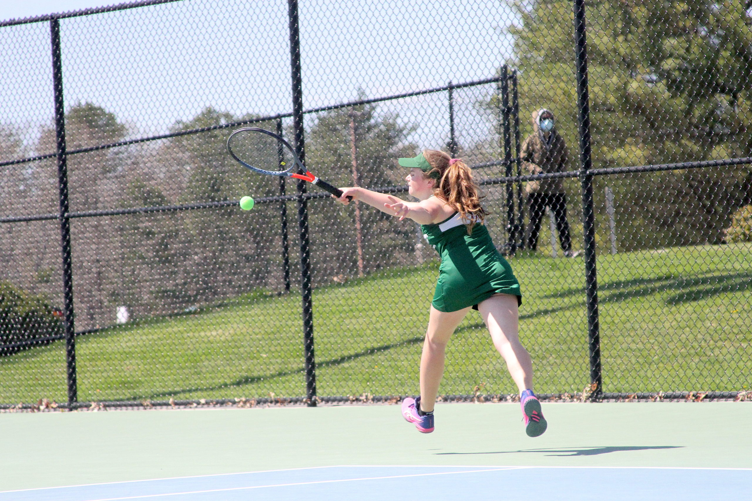 Westhampton Beach freshman Julia Stabile reaches for the ball in her doubles team's quarterfinal matchup.