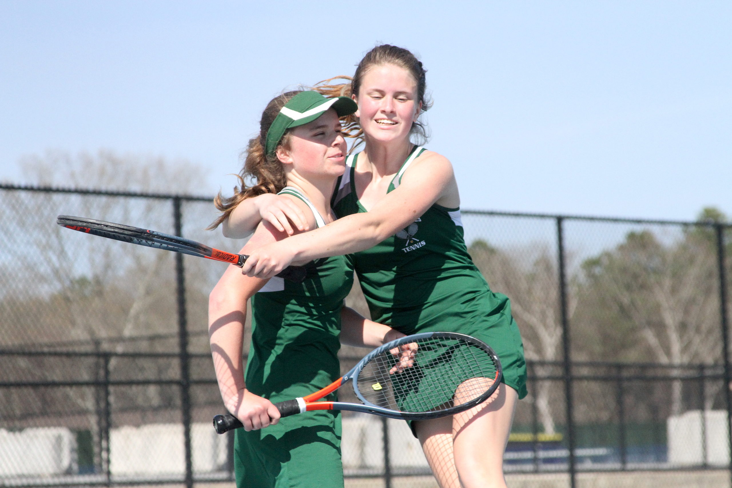 Westhampton Beach freshman Julia Stabile and older sister Katelyn, a junior, celebrate after earning the Division IV doubles title on Tuesday.