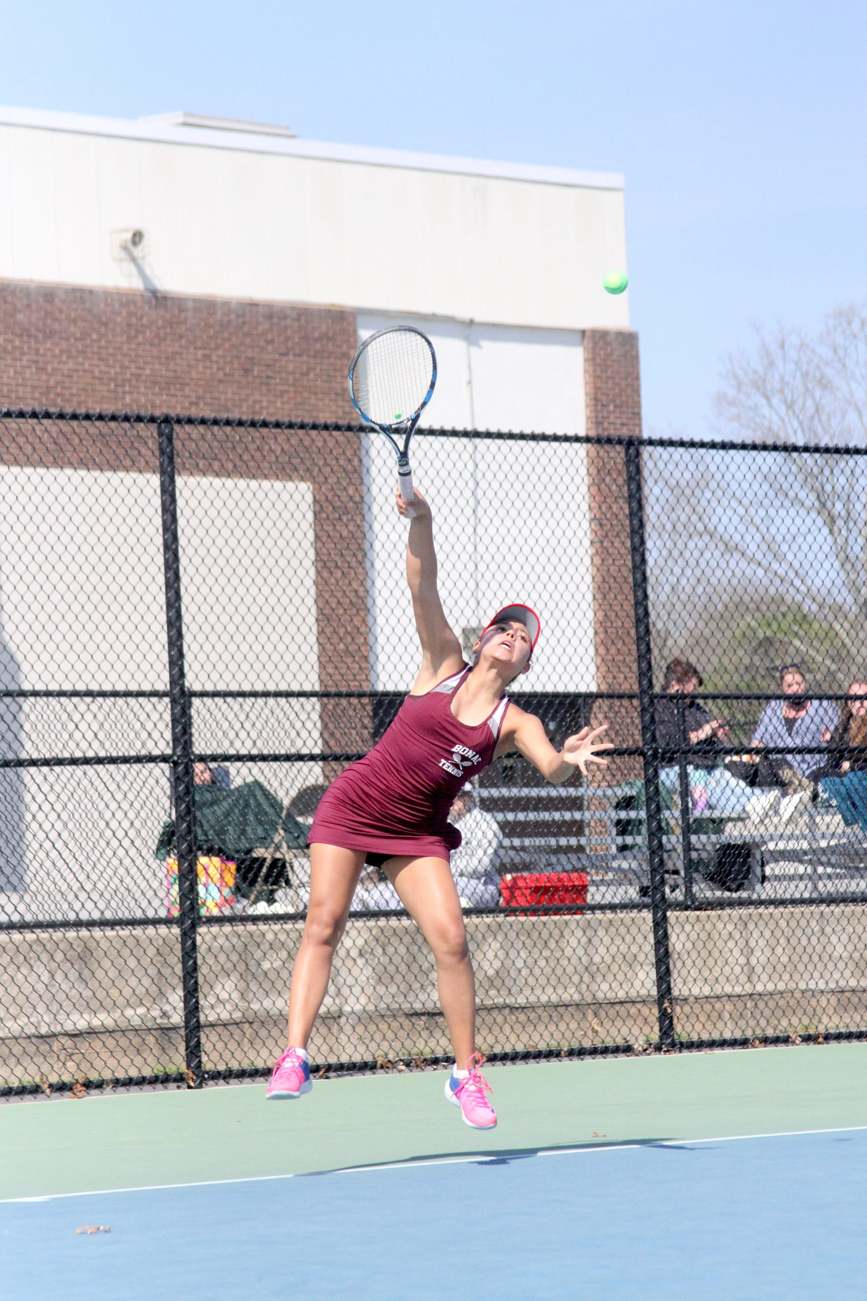 Pierson senior Juliana Barahona serves the ball for East Hampton in the Division IV doubles finals.