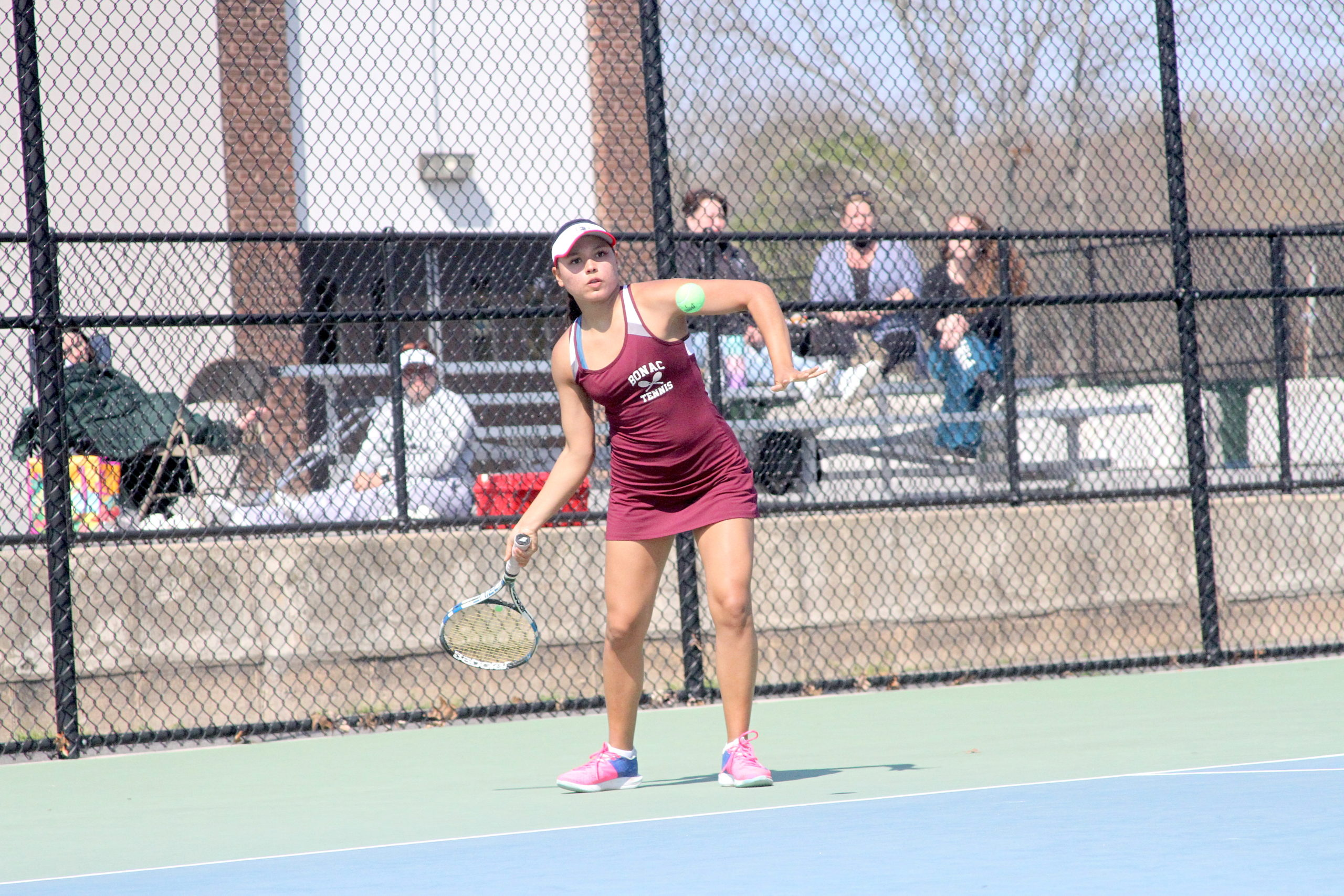 Pierson senior Juliana Barahona returns the ball for East Hampton in the Division IV doubles finals.