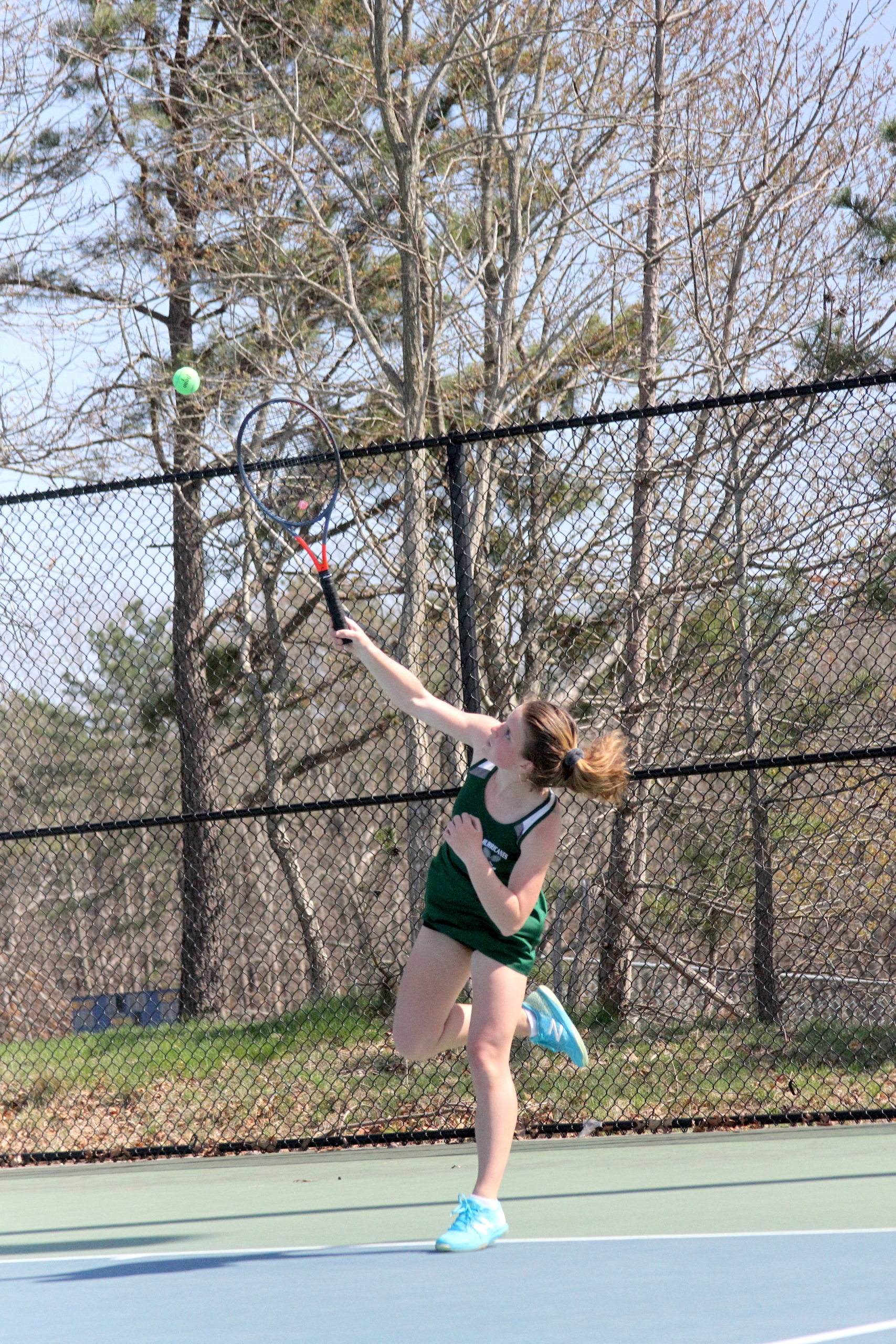 Westhampton Beach junior Katelyn Stabile serves up an ace in the Division IV doubles finals on Tuesday.