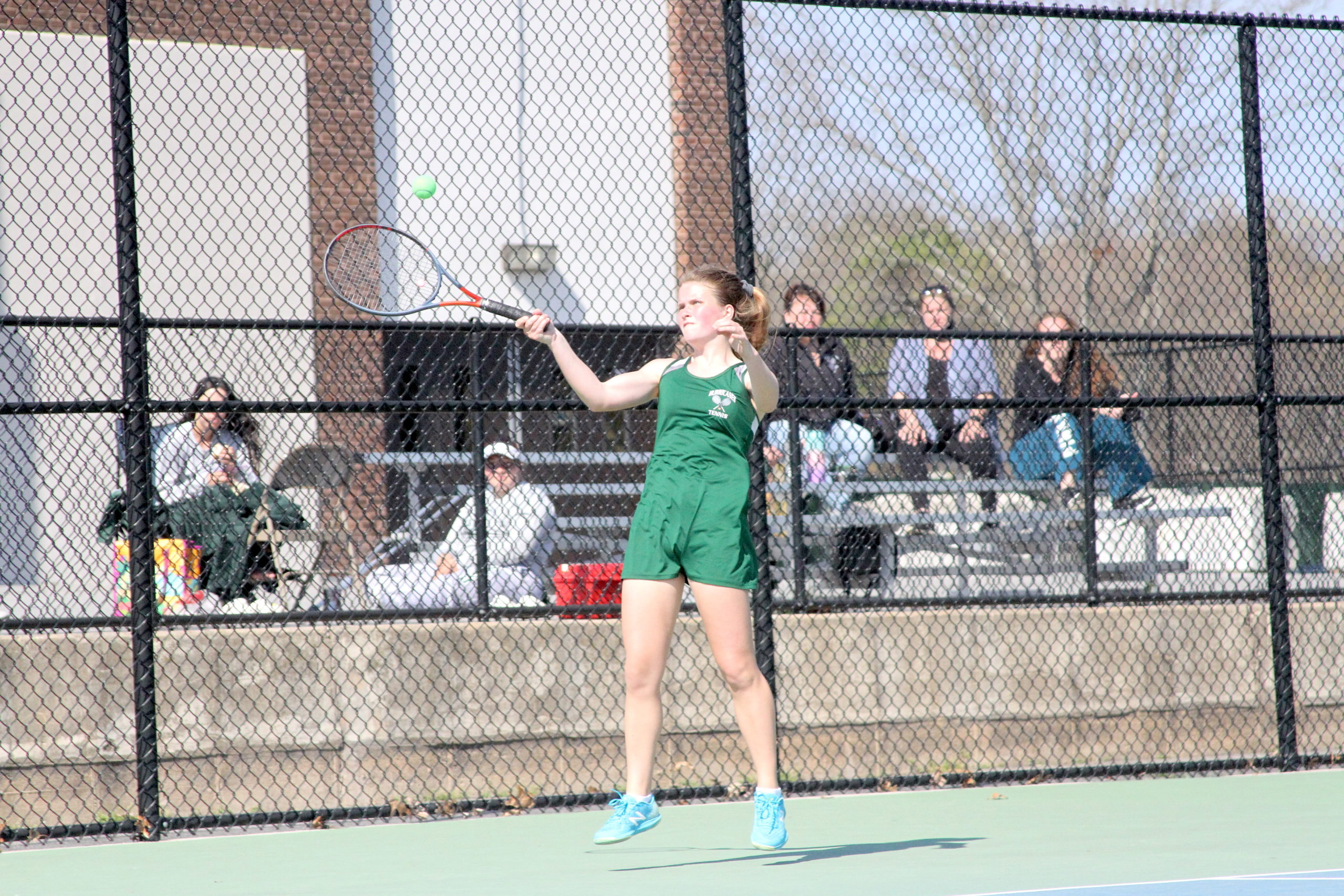Westhampton Beach junior Katelyn Stabile keeps the volley going against East Hampton in the Division IV doubles finals on Tuesday.