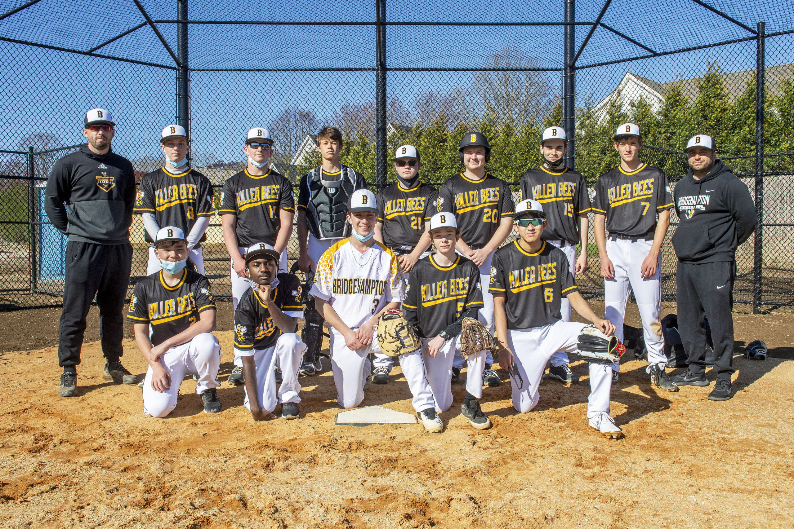 Members of the first Bridgehampton High School baseball team in four decades began practicing this week for an inaugural junior varsity season. Front row, from left: Hugo Kapon, Neo Simmons, Kris Vinski, Will Husband, and Yudai Morikawa. Second row, from left, Coach Lou Liberatore, Scott Vinski, Dylan Fitzgerald, Milo Tompkins, Shawn Gnyp, Jack Boeshore, Evan Buccigross, Eli Wolf, and assistant coach Michael DeRosa. Tyler Fitzgerald, Naiven Mabry, Kaylee Sanchez, and Leah Meyerson are missing. MICHAEL HELLER
