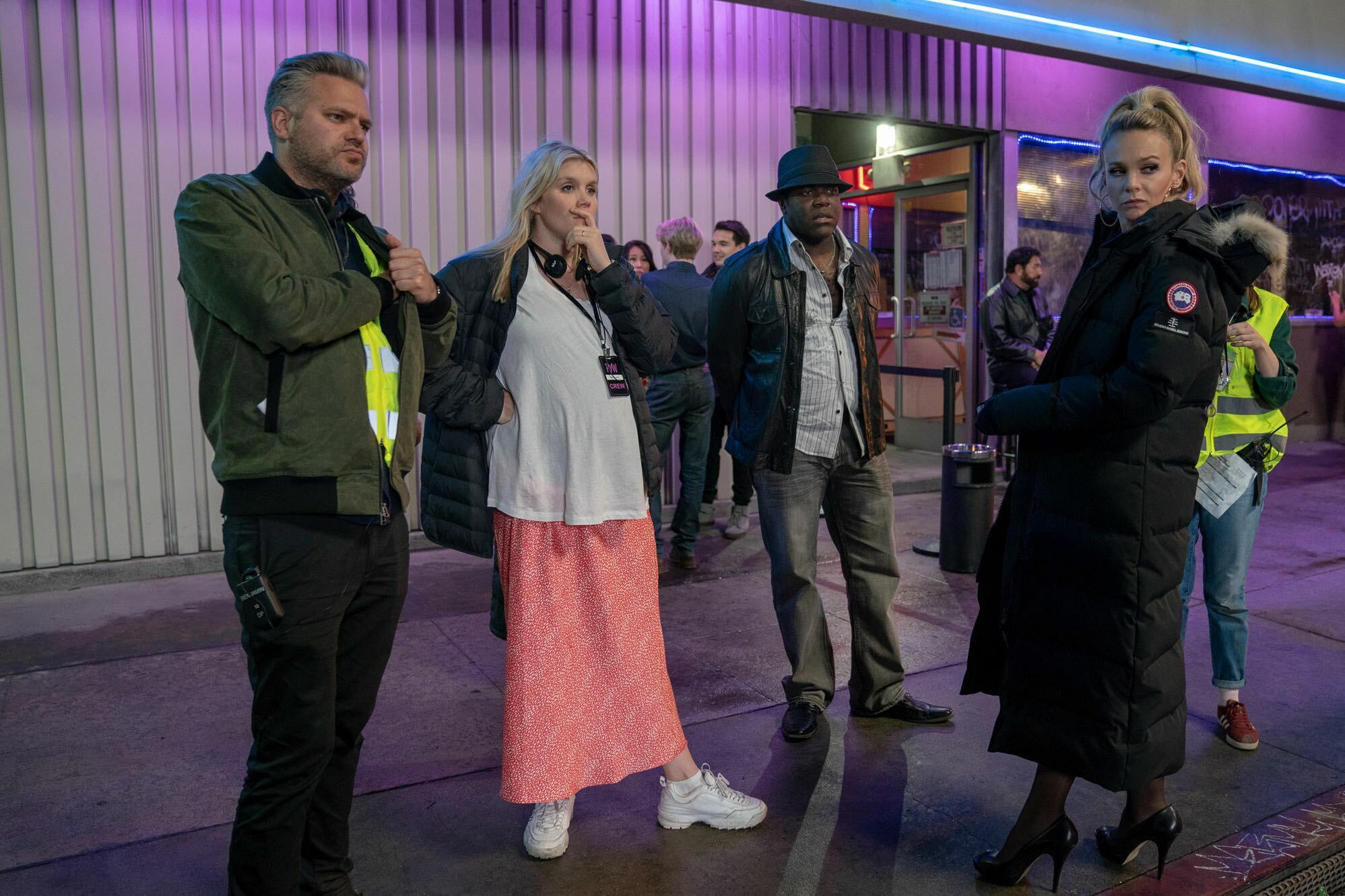 From left, director of photography Benjamin Kracun, writer/director Emerald Fennell, actor Sam Richardson, and actor Carey Mulligan on the set of