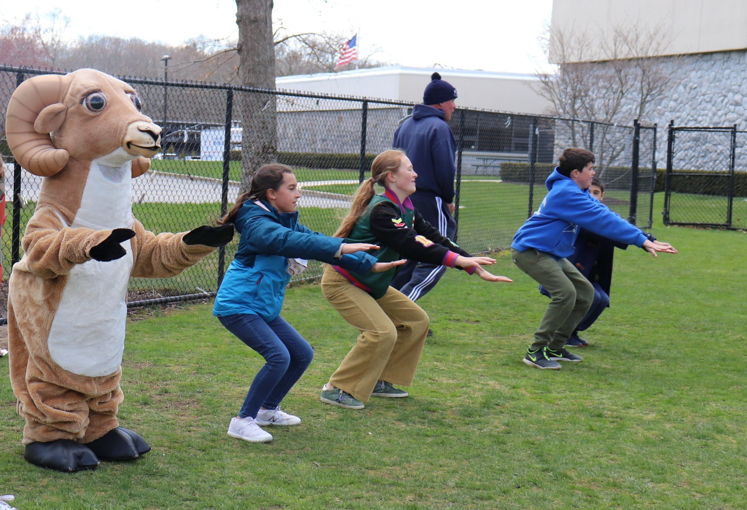 Raynor Country Day School students and staff, as well as the school mascot, Rocky join in the schoolwide Earth Day celebration: Healthy You—Healthy Me!